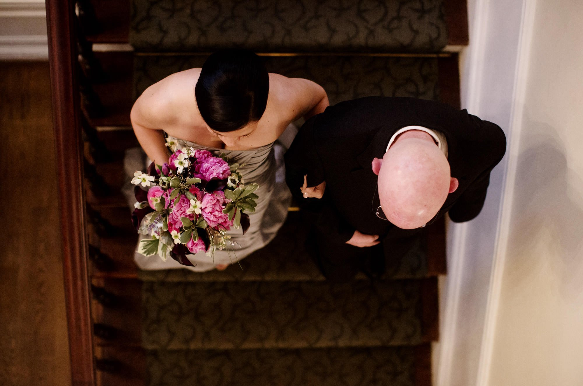 The bride and her father walk down the steps during the wedding ceremony at Woodend Sanctuary.