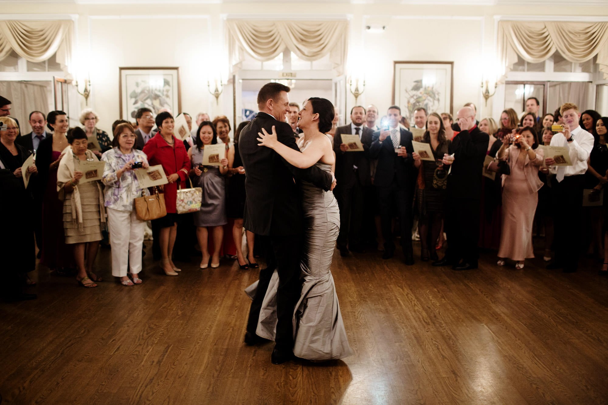 The bride and groom share their first dance during the reception of their Woodend Sanctuary Wedding.