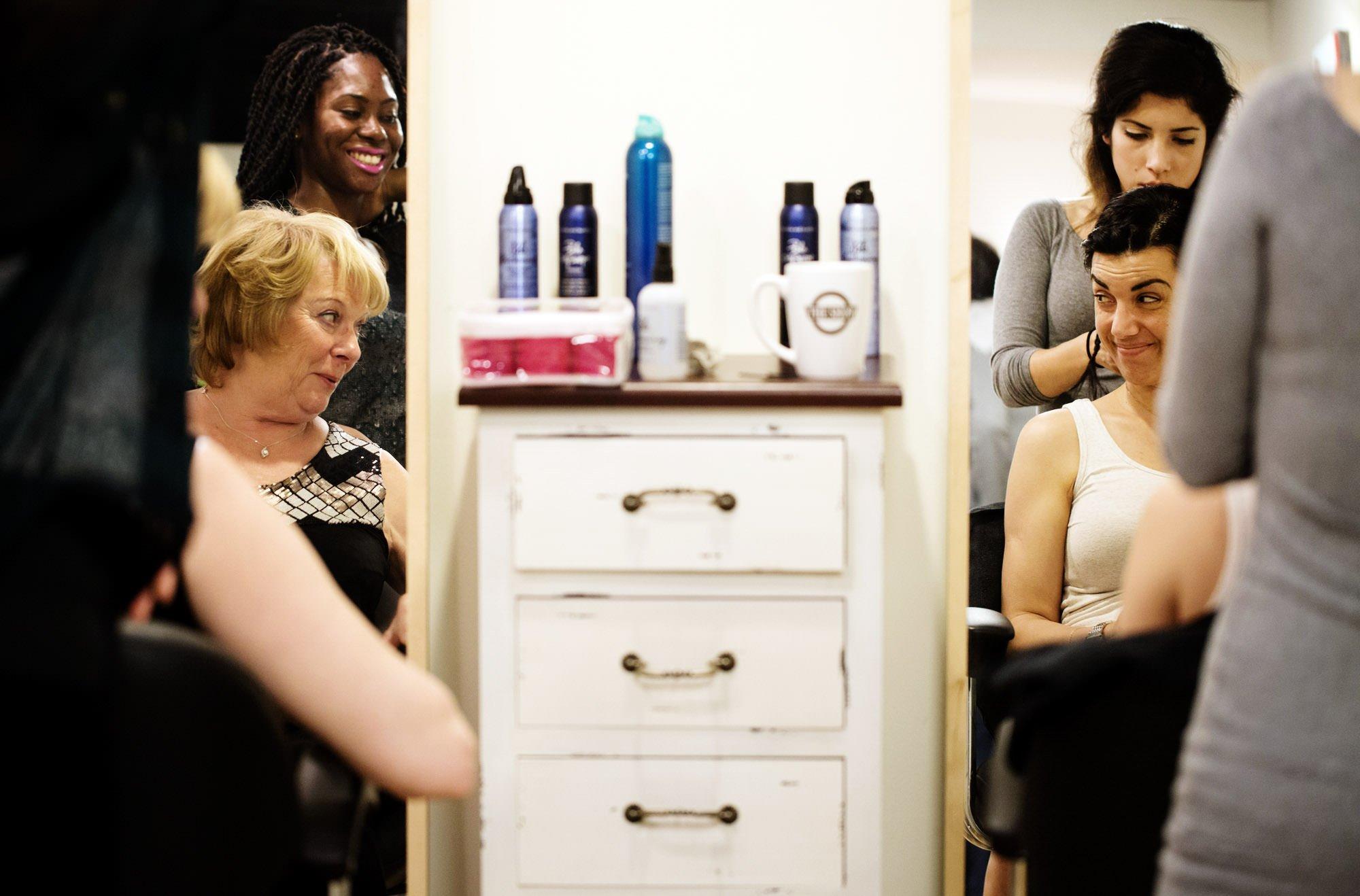 Bridesmaids get their hair done.