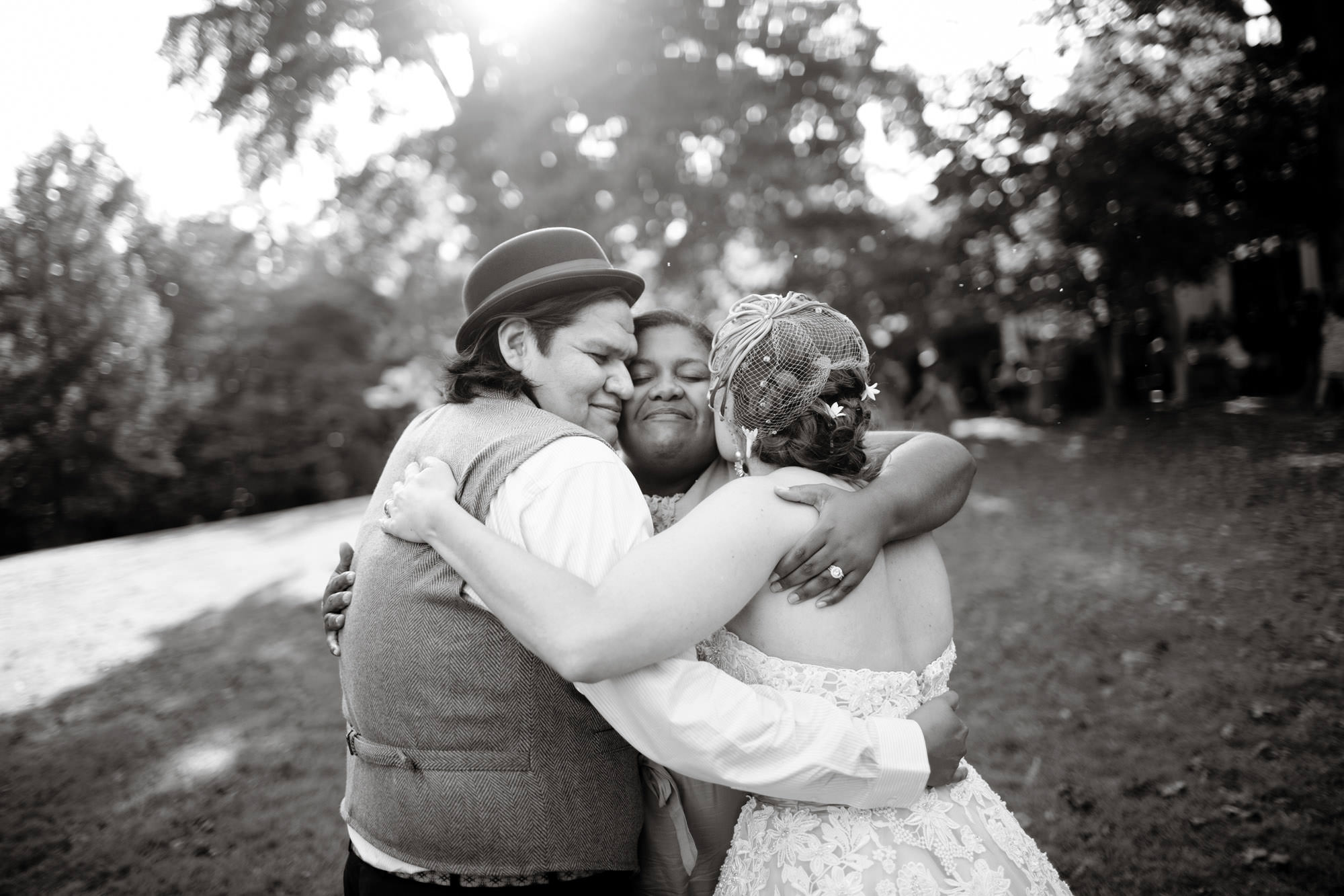 The couple receives a hug on their wedding day at Woodend Sanctuary and Mansion.