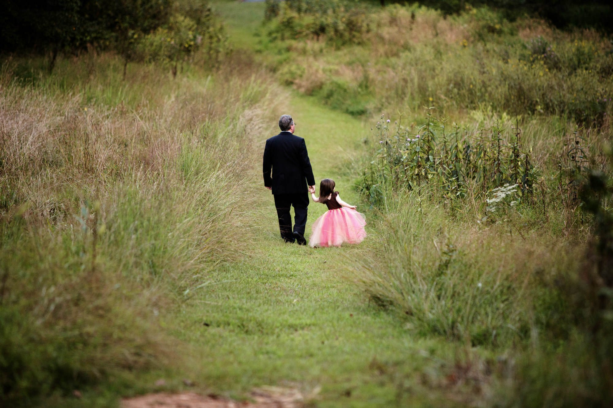 The flower girl goes for a walk during this Woodend Sanctuary and Mansion wedding.