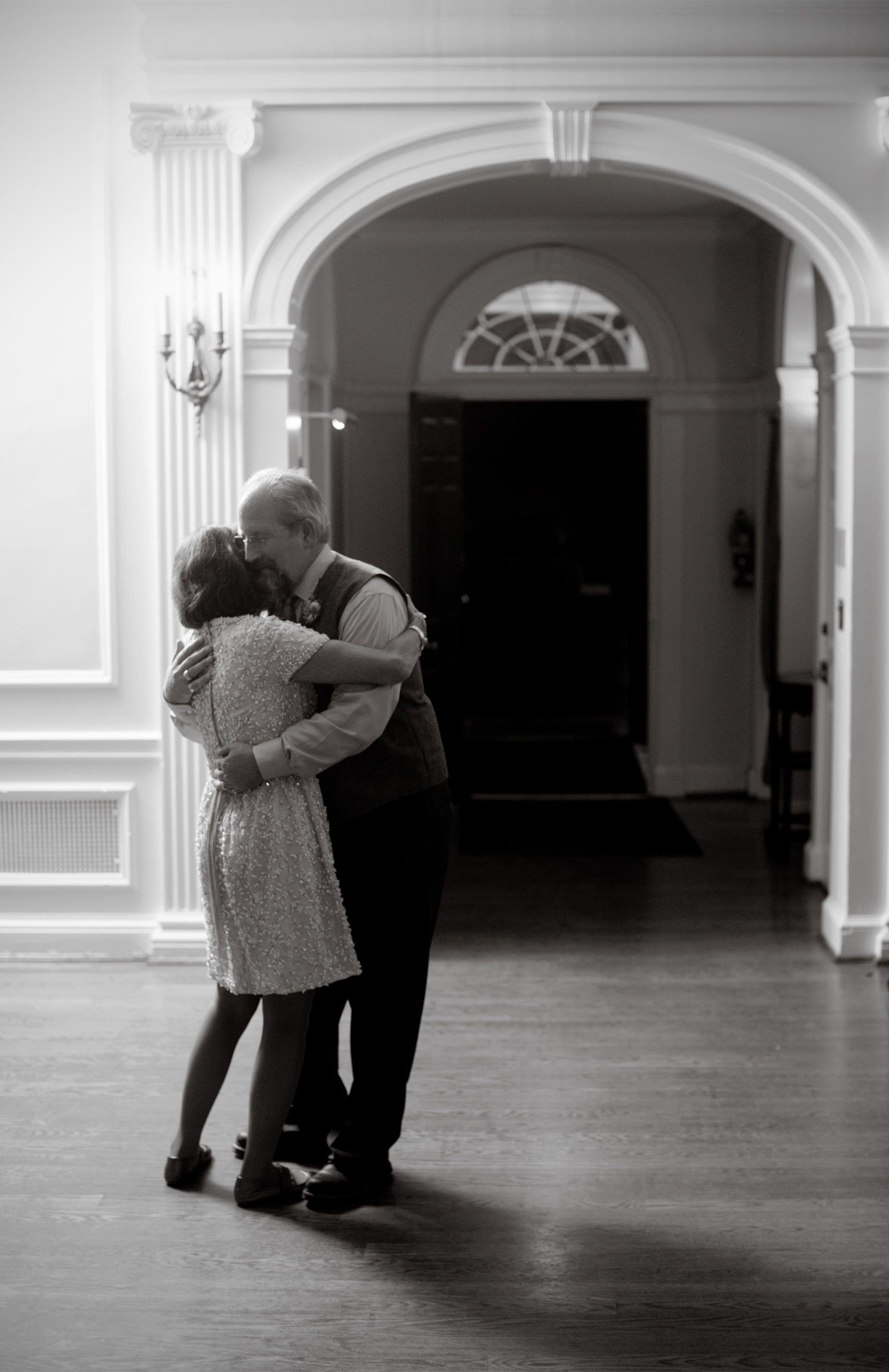 The parents of the bride dance alone on the Woodend Sanctuary and Mansion wedding day.
