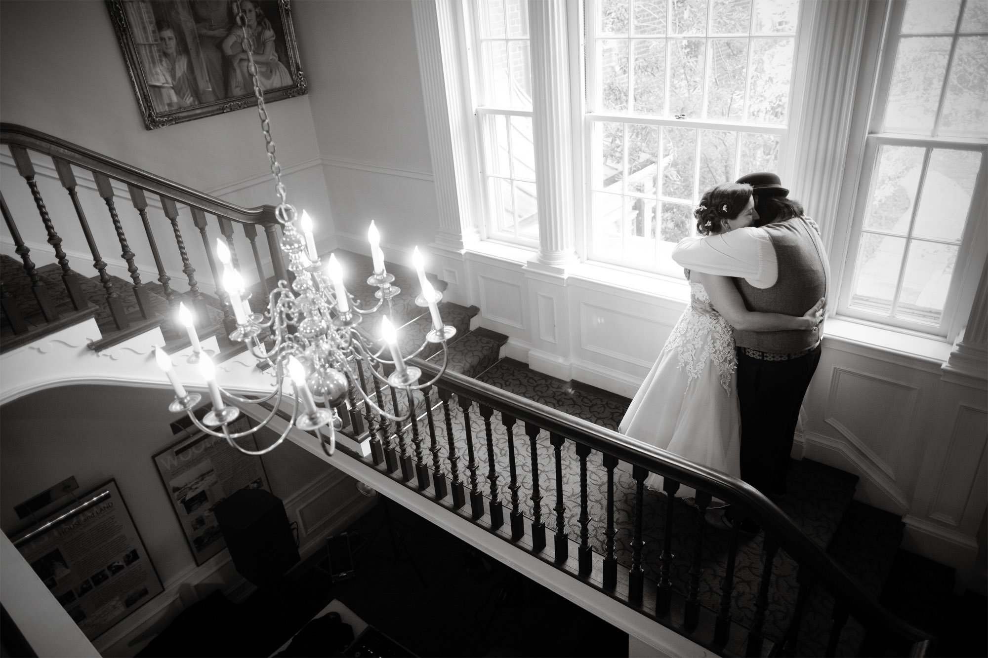 The bride and groom hug on the wedding day at Woodend Sanctuary and Mansion.