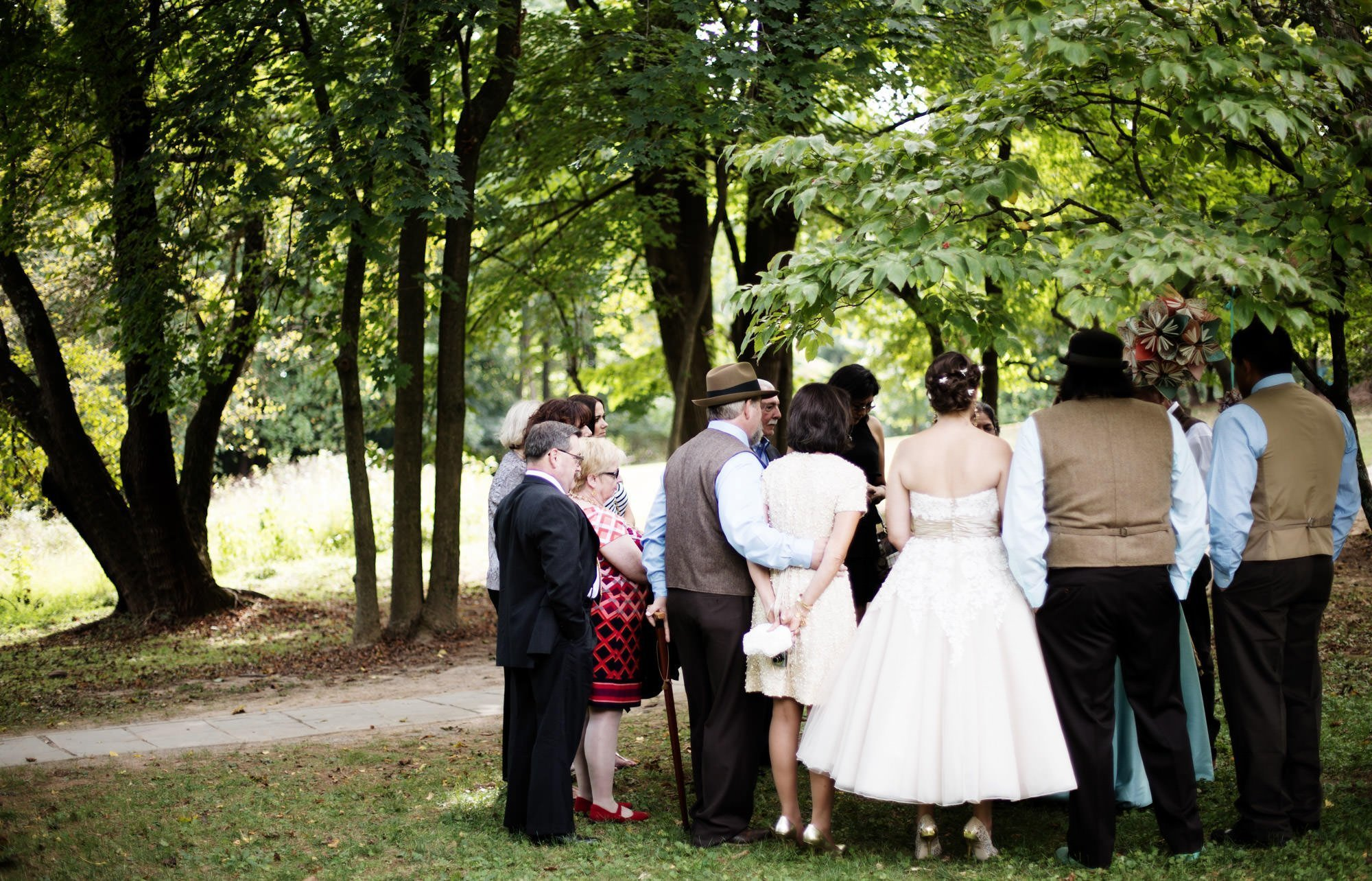 The couple participates in a private ceremony on their vWoodend Sanctuary and Mansion Wedding day.