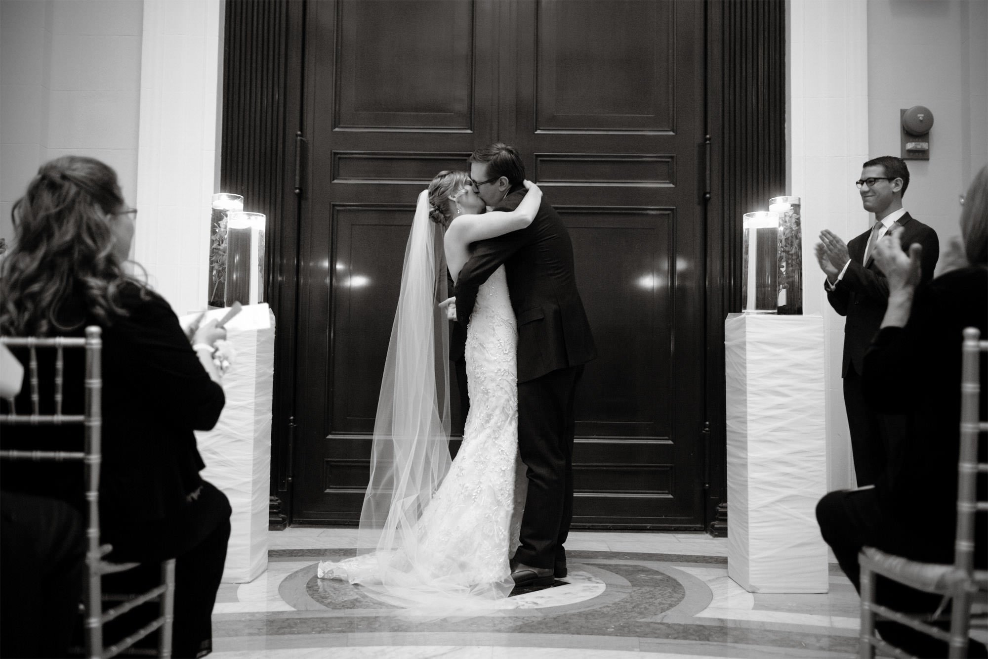 The bride and groom share their first kiss as husband and wife during the Carnegie Institute for Science Wedding ceremony.