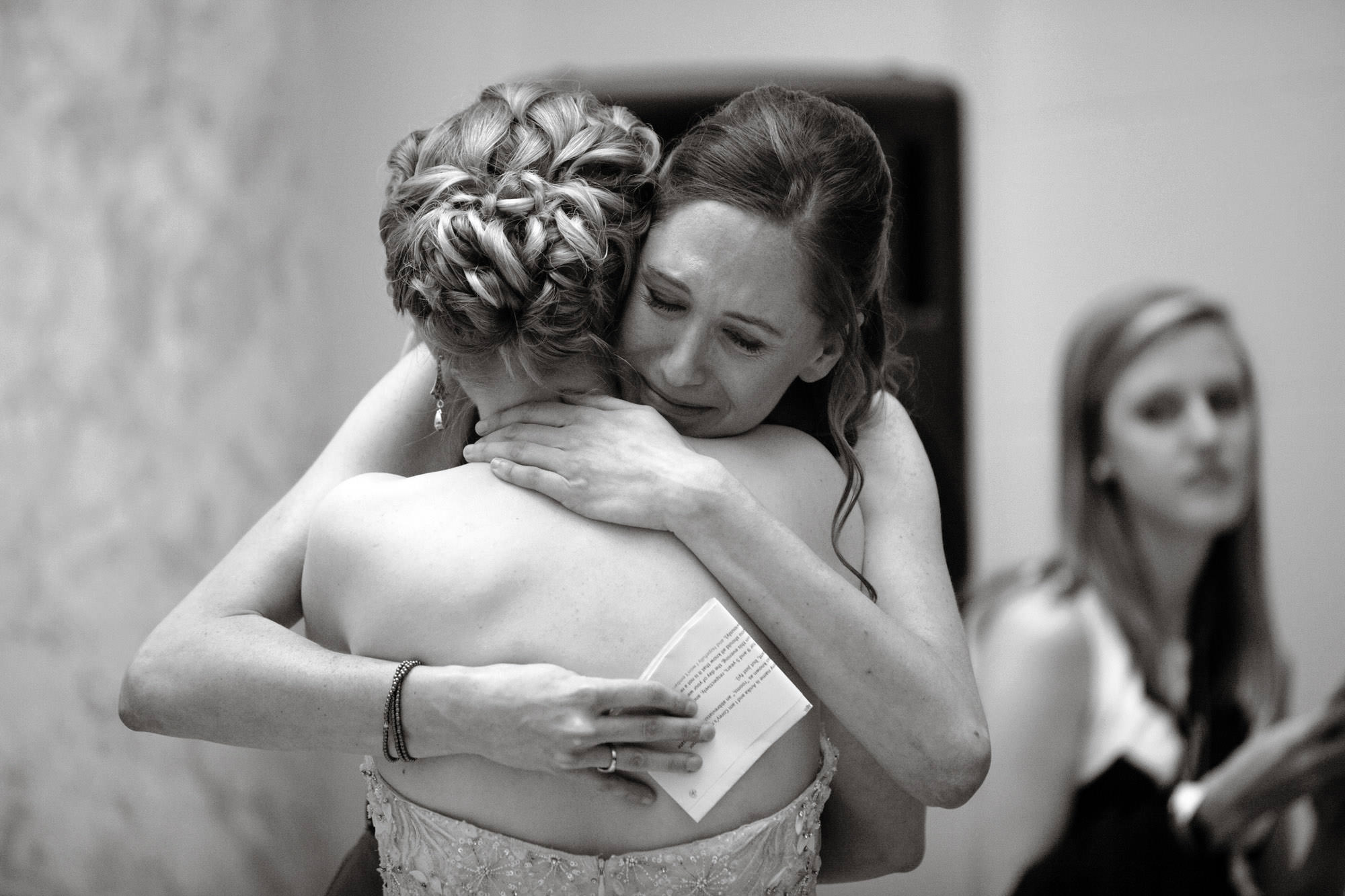 The maid of honor hugs the bride after giving a toast during the Carnegie Institute for Science Wedding reception.