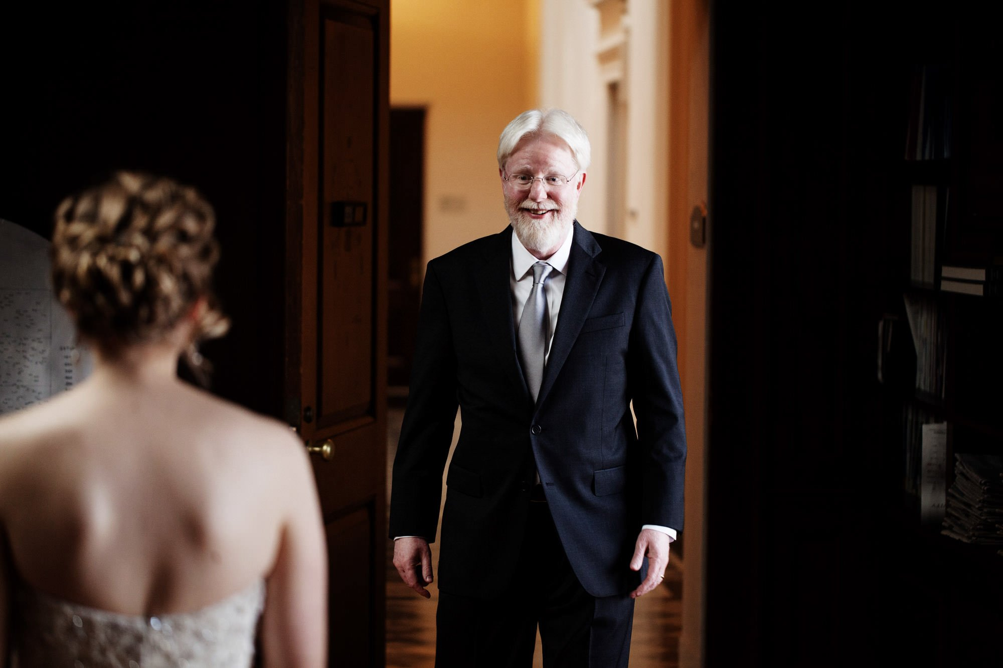The father of the bride looks at his daughter in the wedding dress before the Carnegie Institute for Science Wedding ceremony.