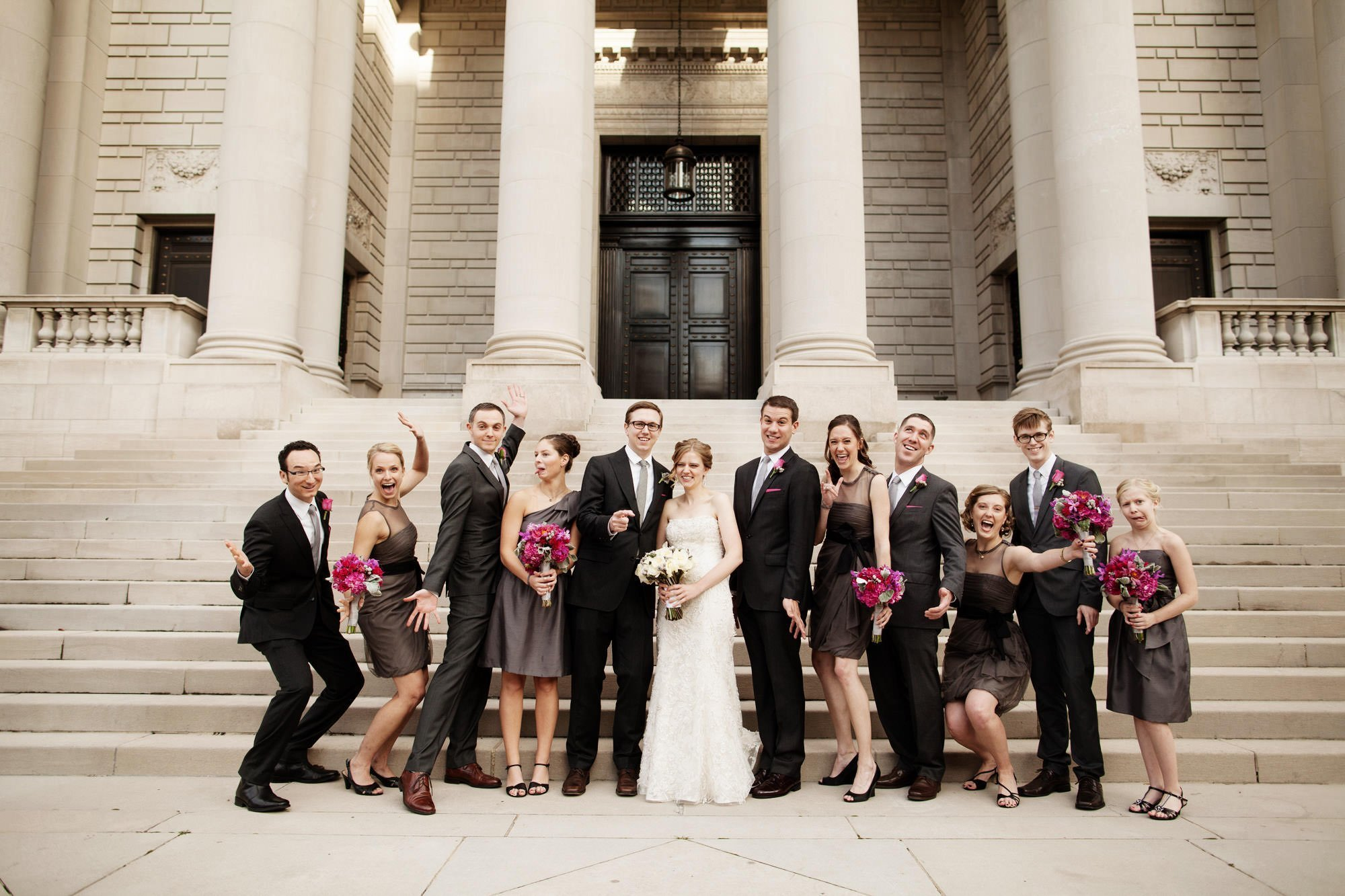 The wedding party poses for a portrait on the steps of the Carnegie Institute for Science.