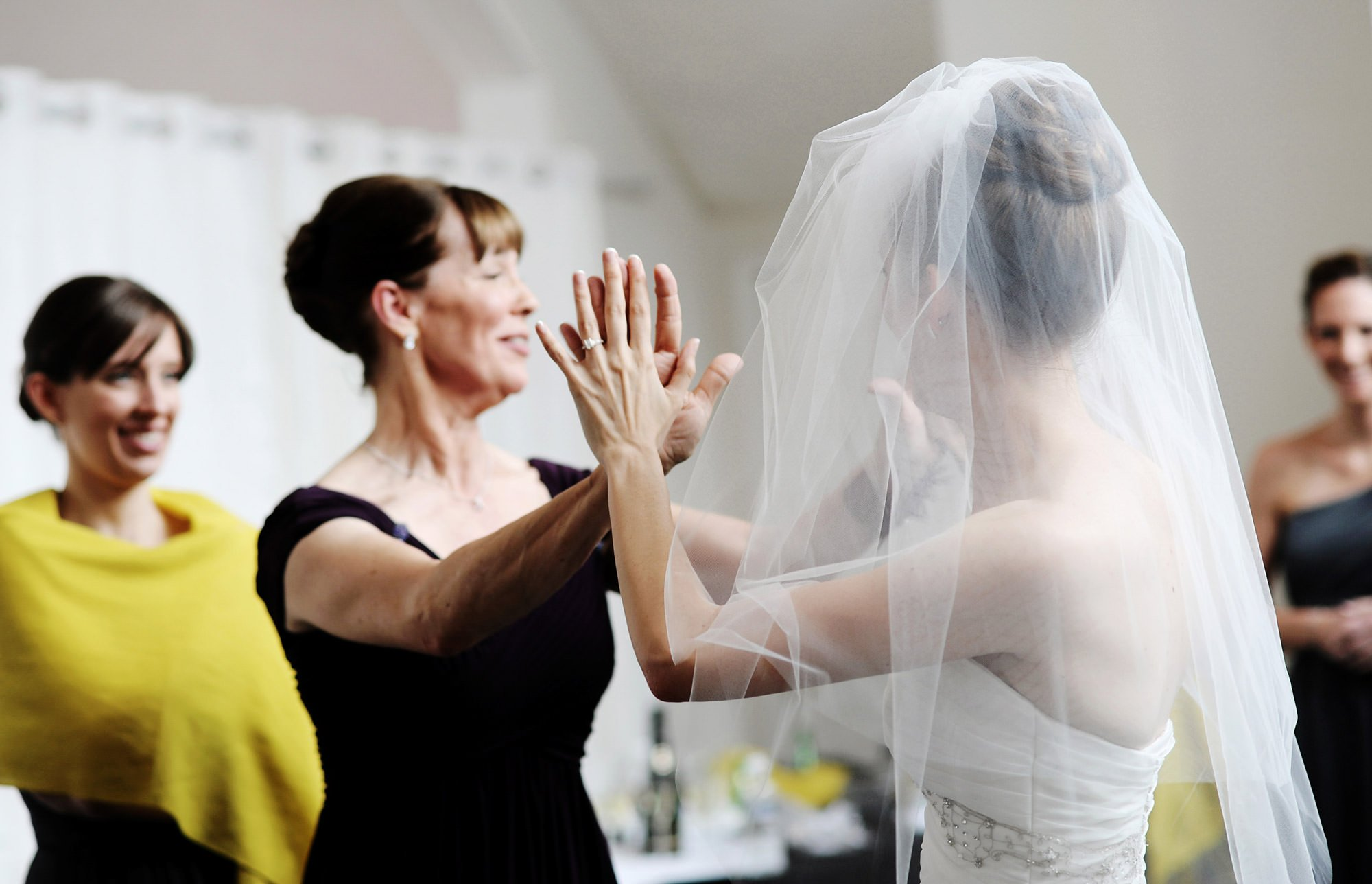 The bride gives her mom a high-five before the wedding ceremony at Celebrations at the Bay.