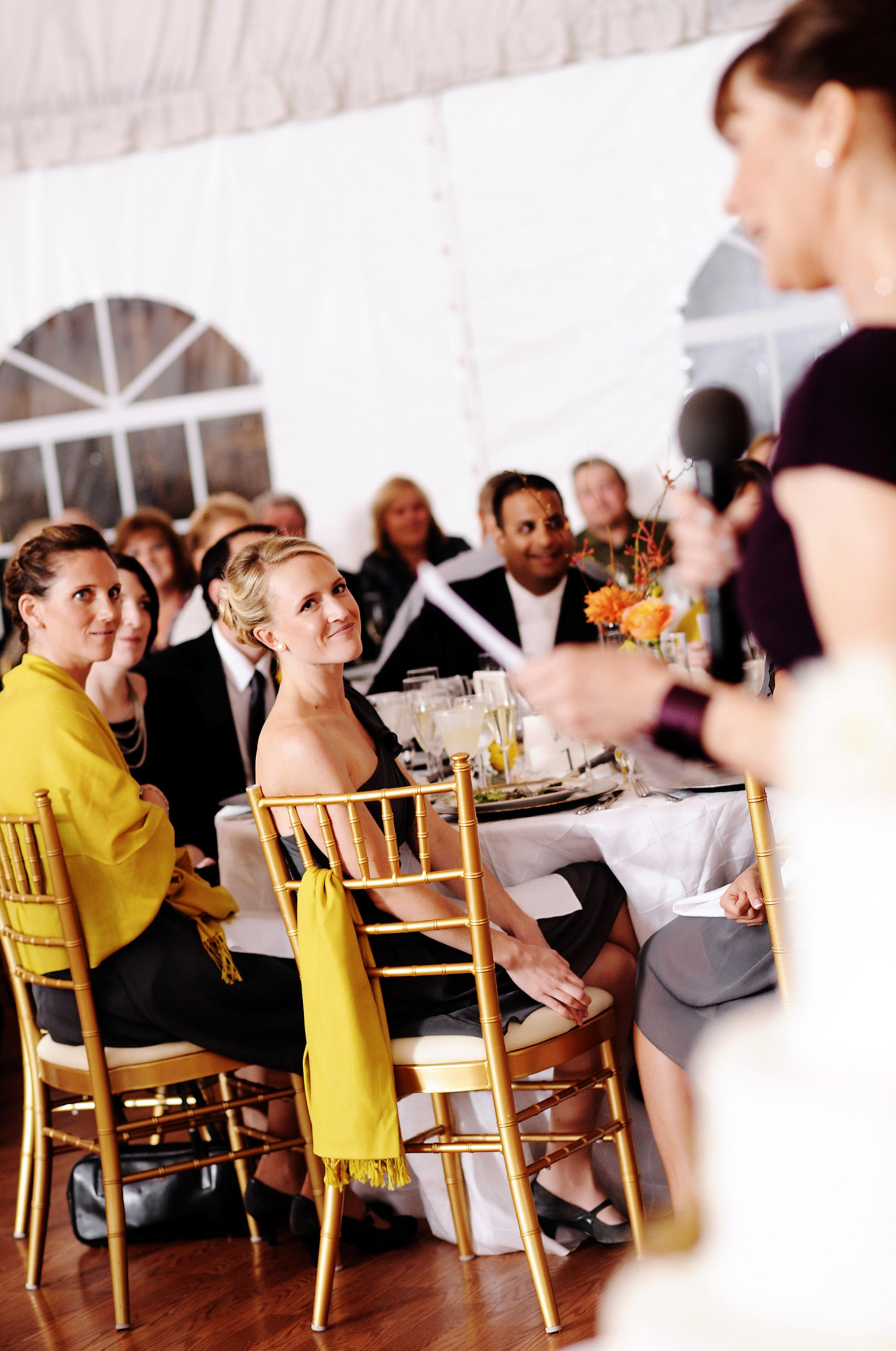 Guests listen to toasts at the Celebrations at the Bay wedding reception.
