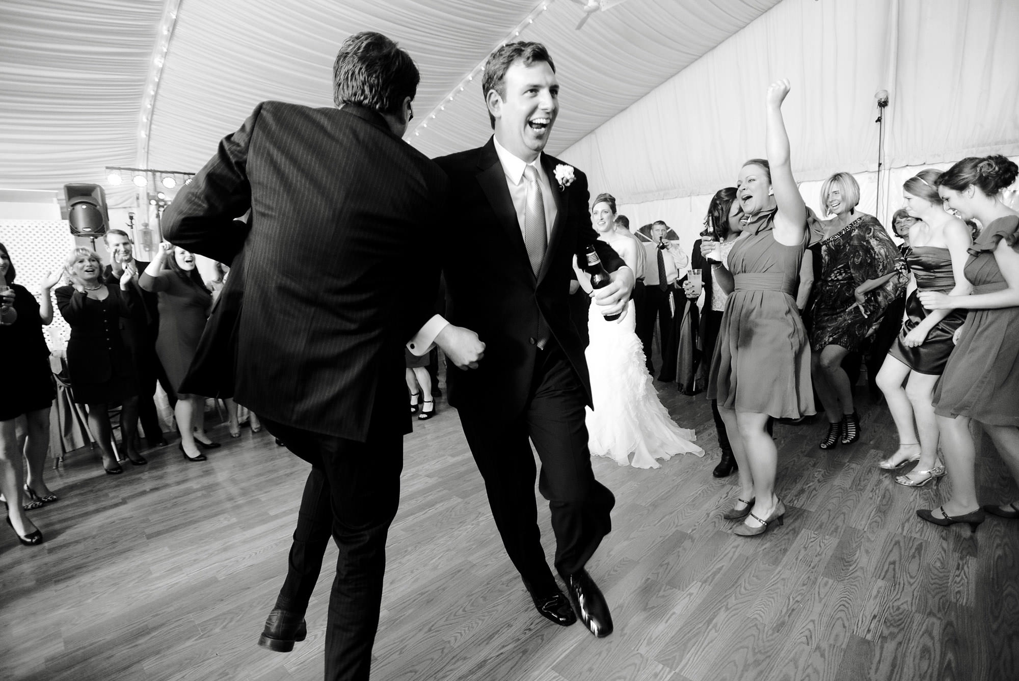 The groom dances during the reception.