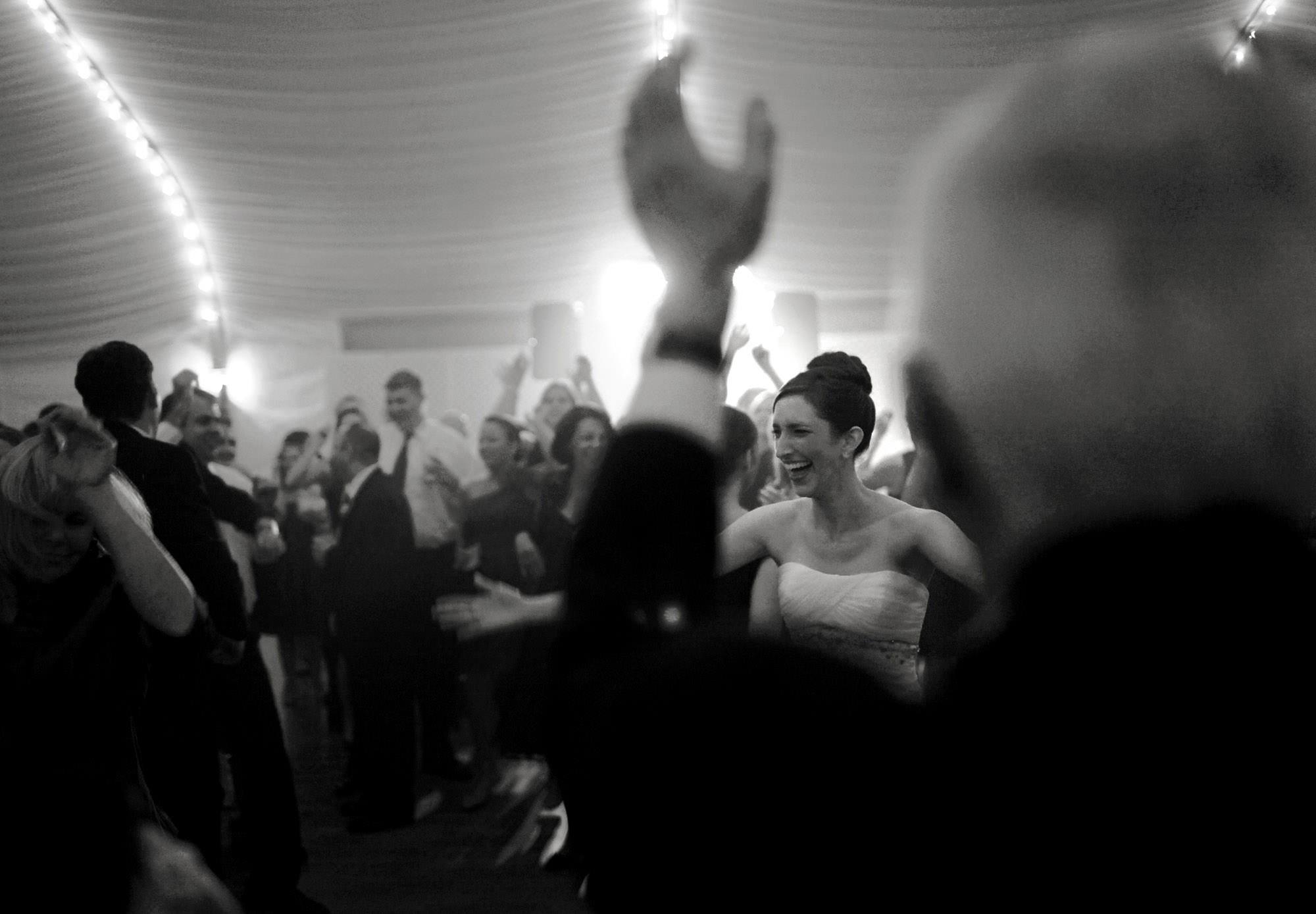 The bride dances with her guests during her wedding reception at Celebrations at the Bay.