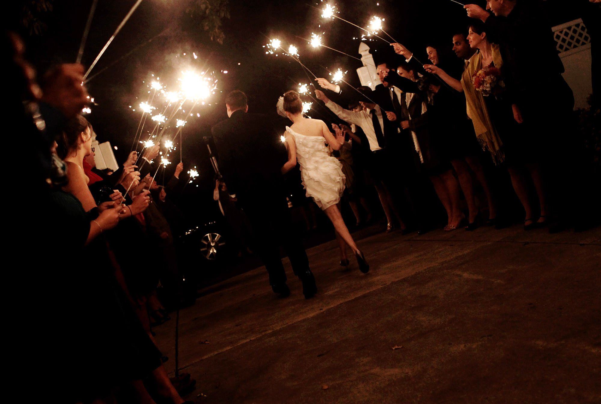 The bride and groom leave the venue during their sparkler sendoff at Celebrations at the Bay.