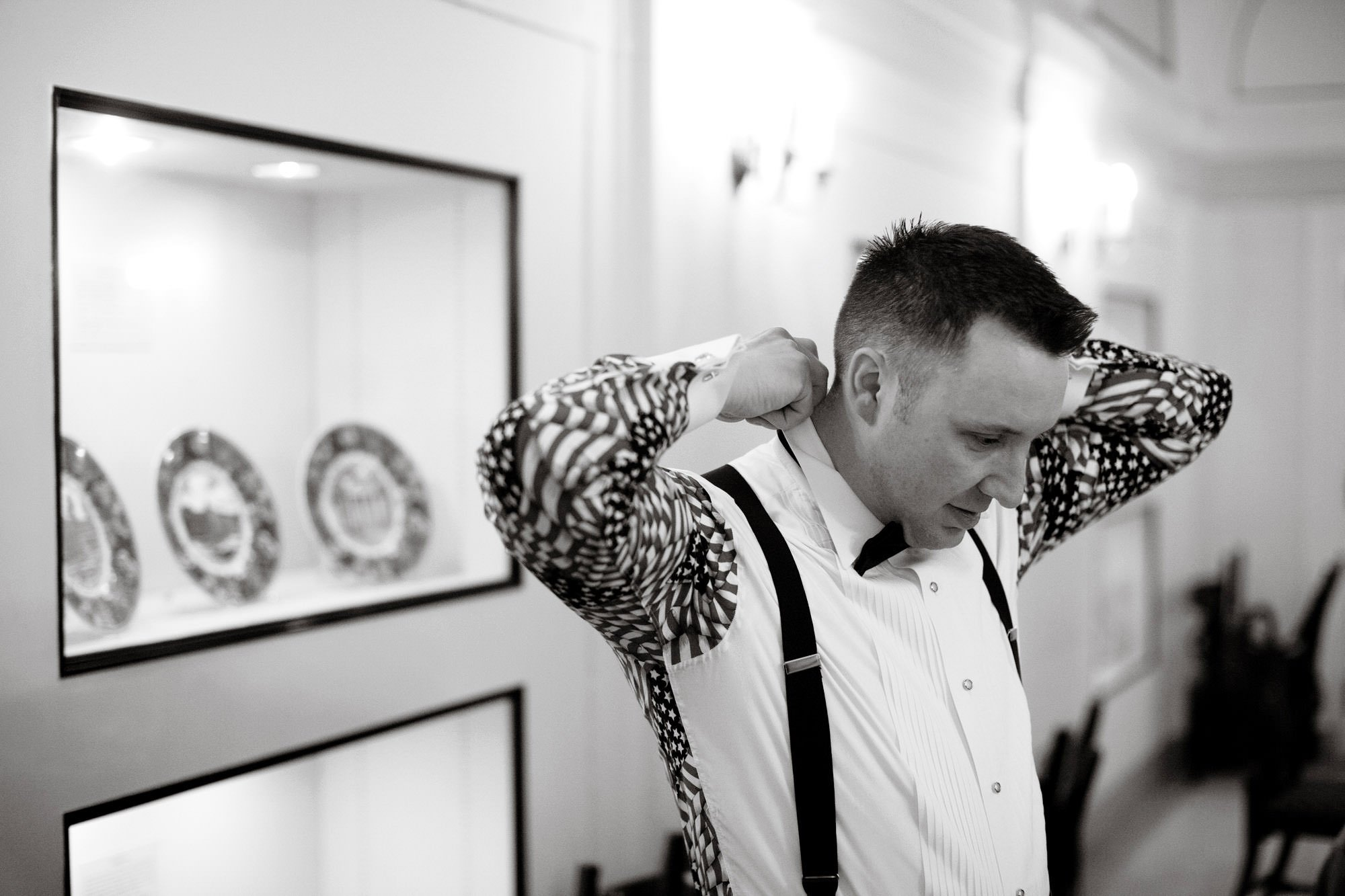 The groom gets ready for his DAR Memorial Continental Hall Wedding ceremony.