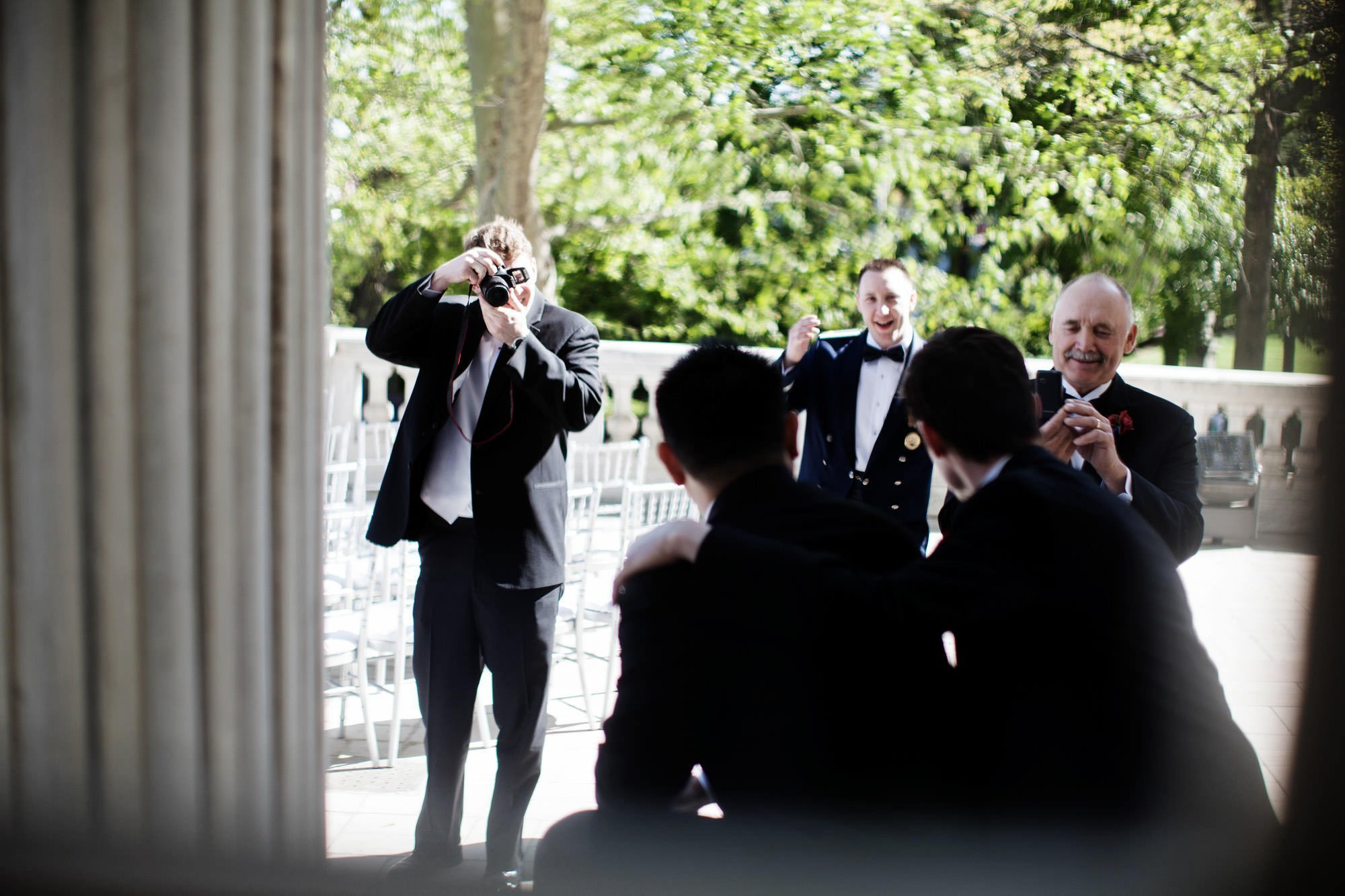 Groomsmen pose for pictures before the ceremony.