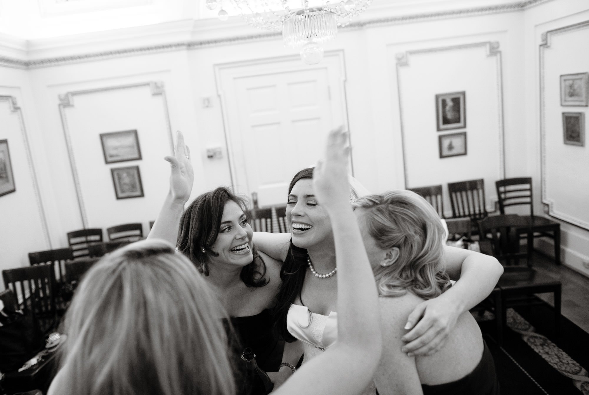 The bride smiles with her bridesmaids before her DAR Memorial Continental Hall Wedding ceremony.