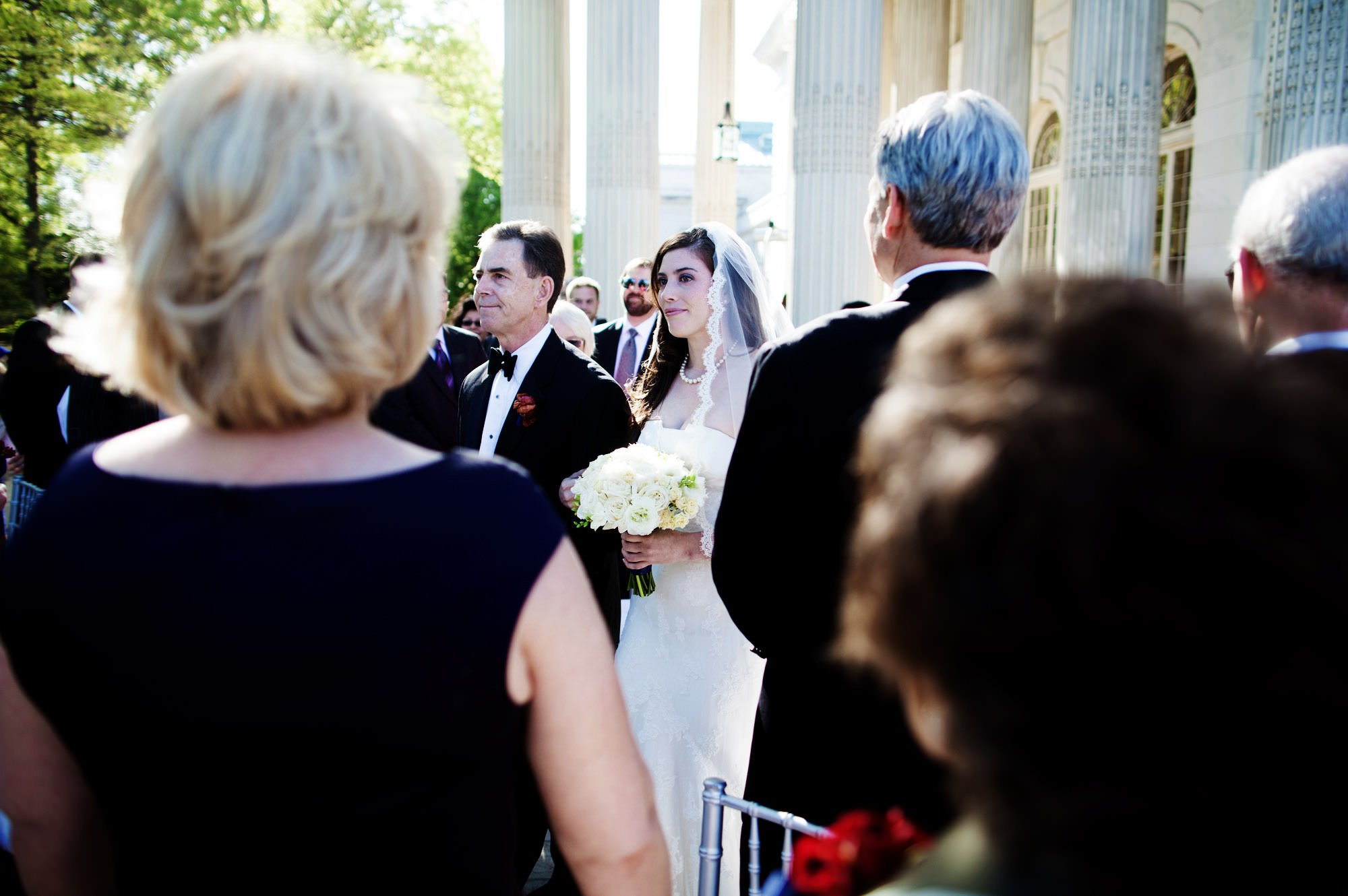 The bride is escorted down the aisle by her father during the DAR Memorial Continental Hall Wedding ceremony.