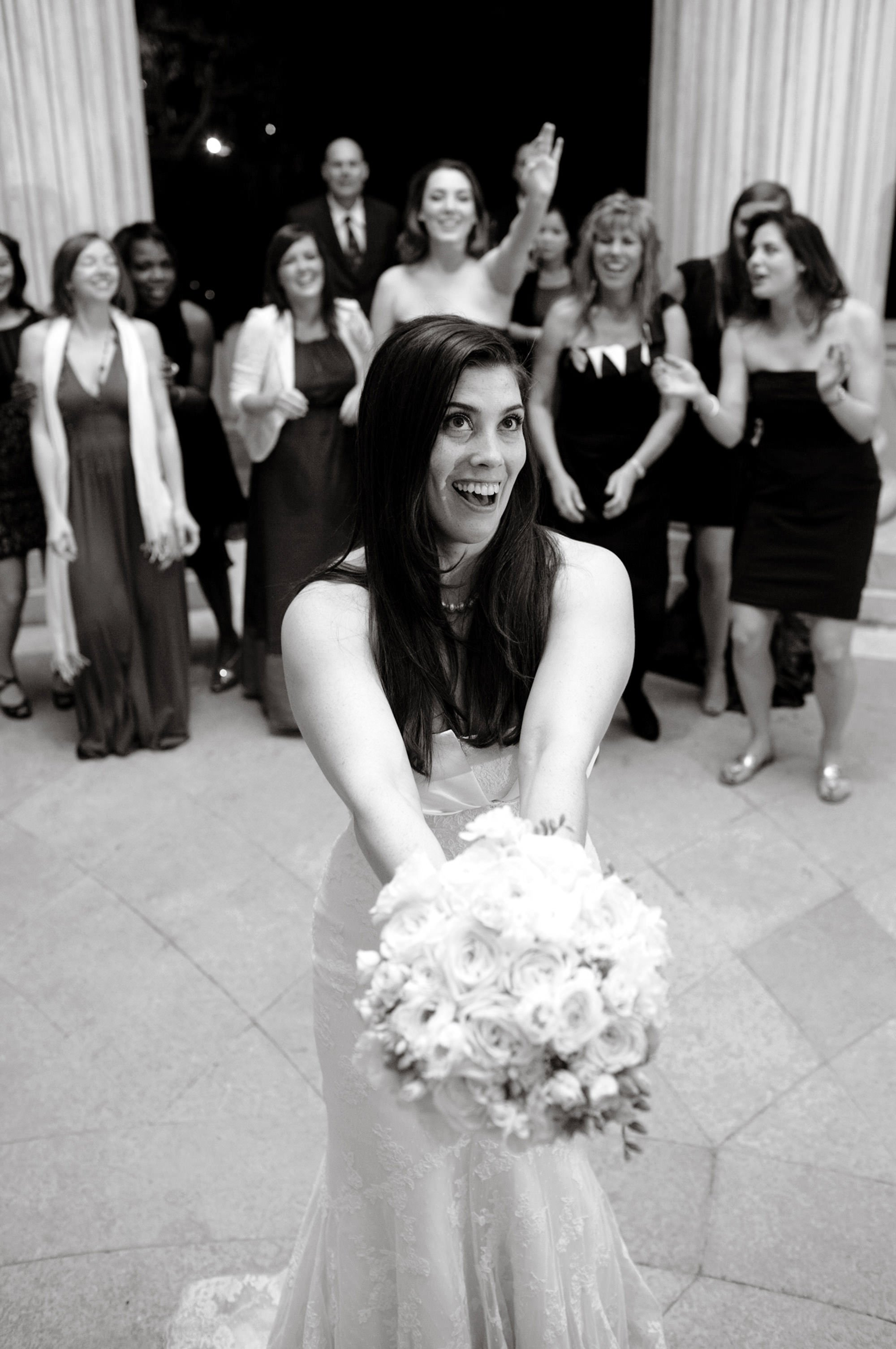 The bride prepares to toss her bouquet during the DAR Memorial Continental Hall Wedding reception.