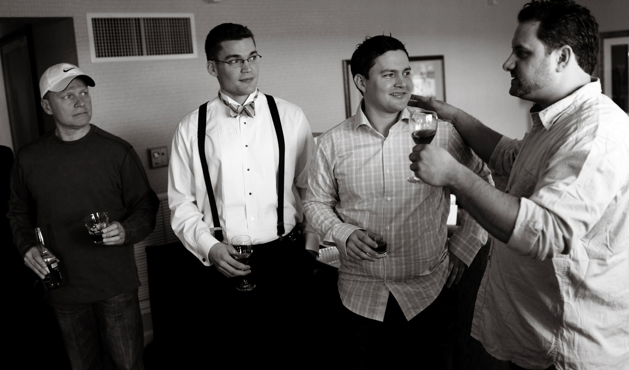 The groomsmen toast to the groom on his wedding day.