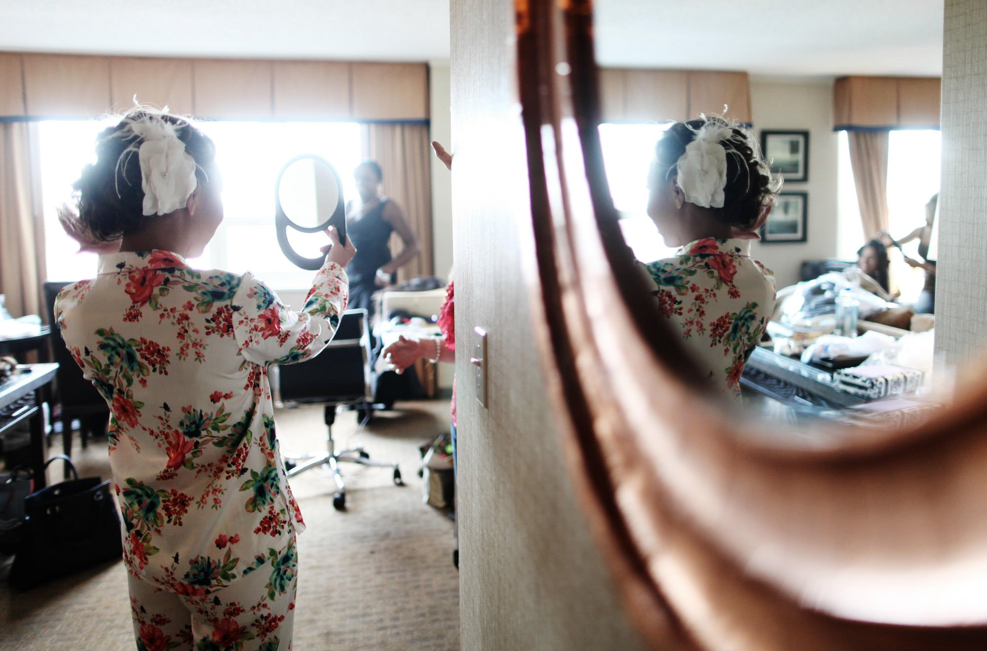 The bride gets ready before her George Peabody Library wedding reception.