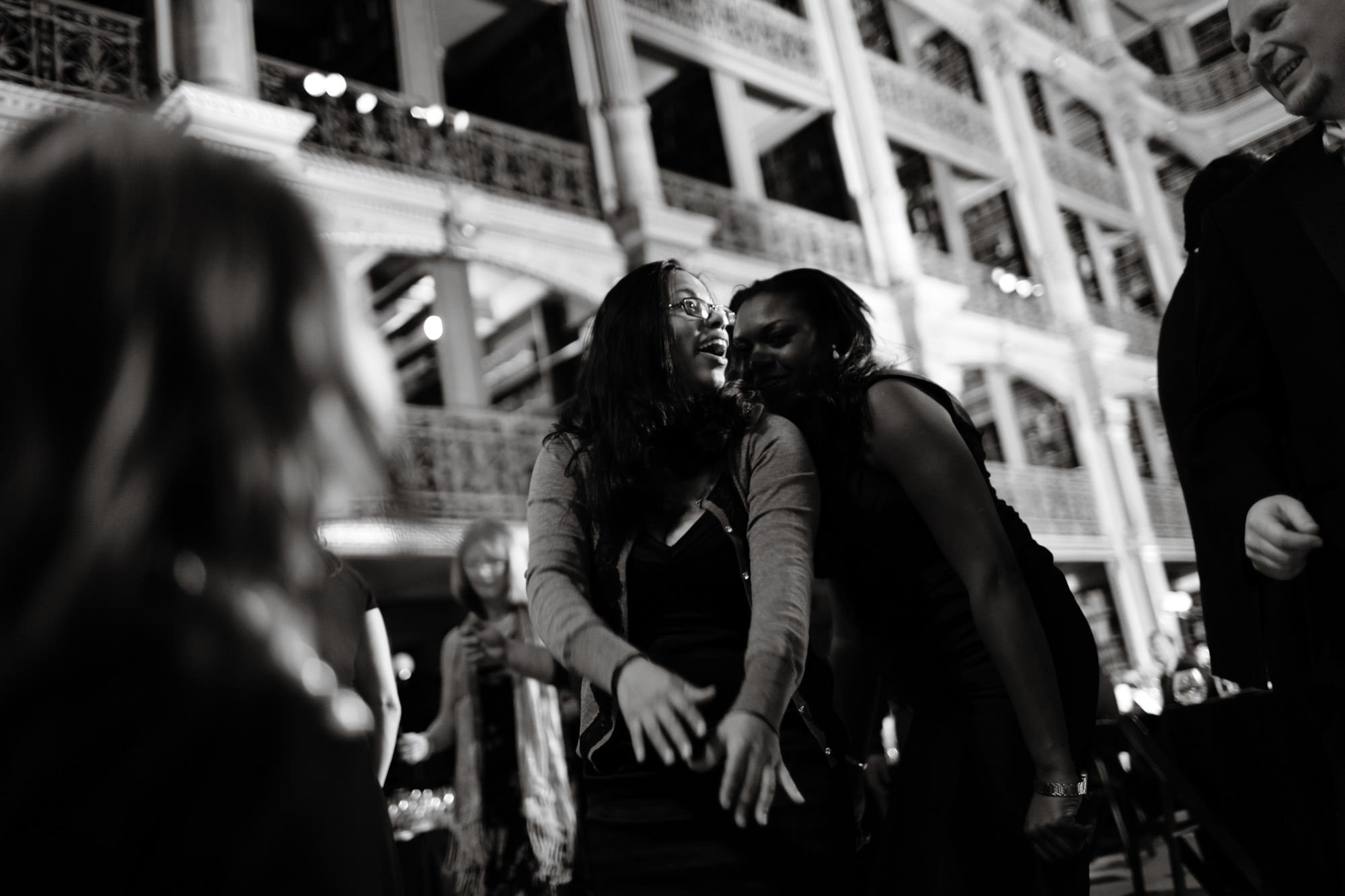 Guests dance during the wedding reception at George Peabody Library.