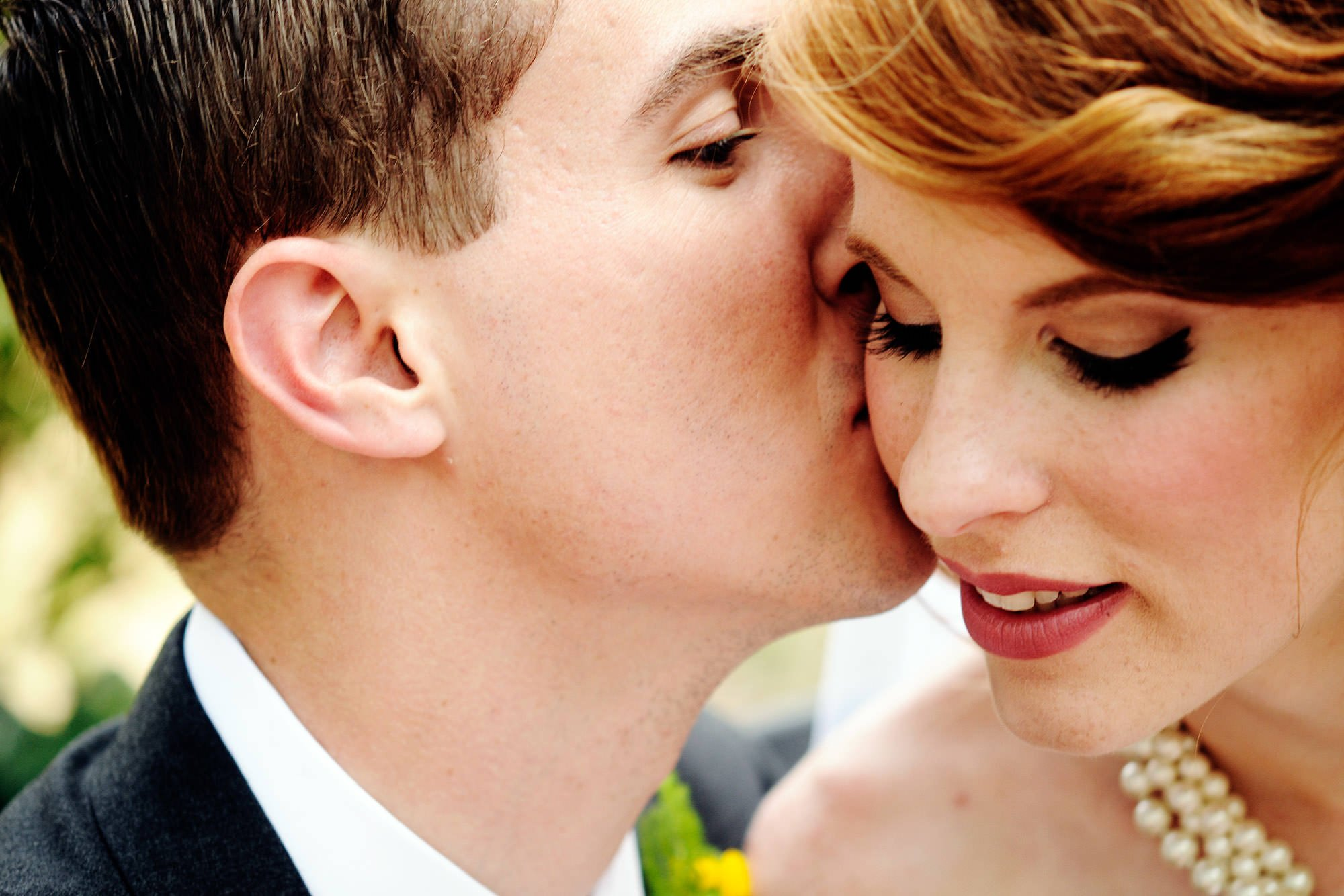 The couple kisses in Lafayette Park in Washington, DC before their Hay Adams wedding.
