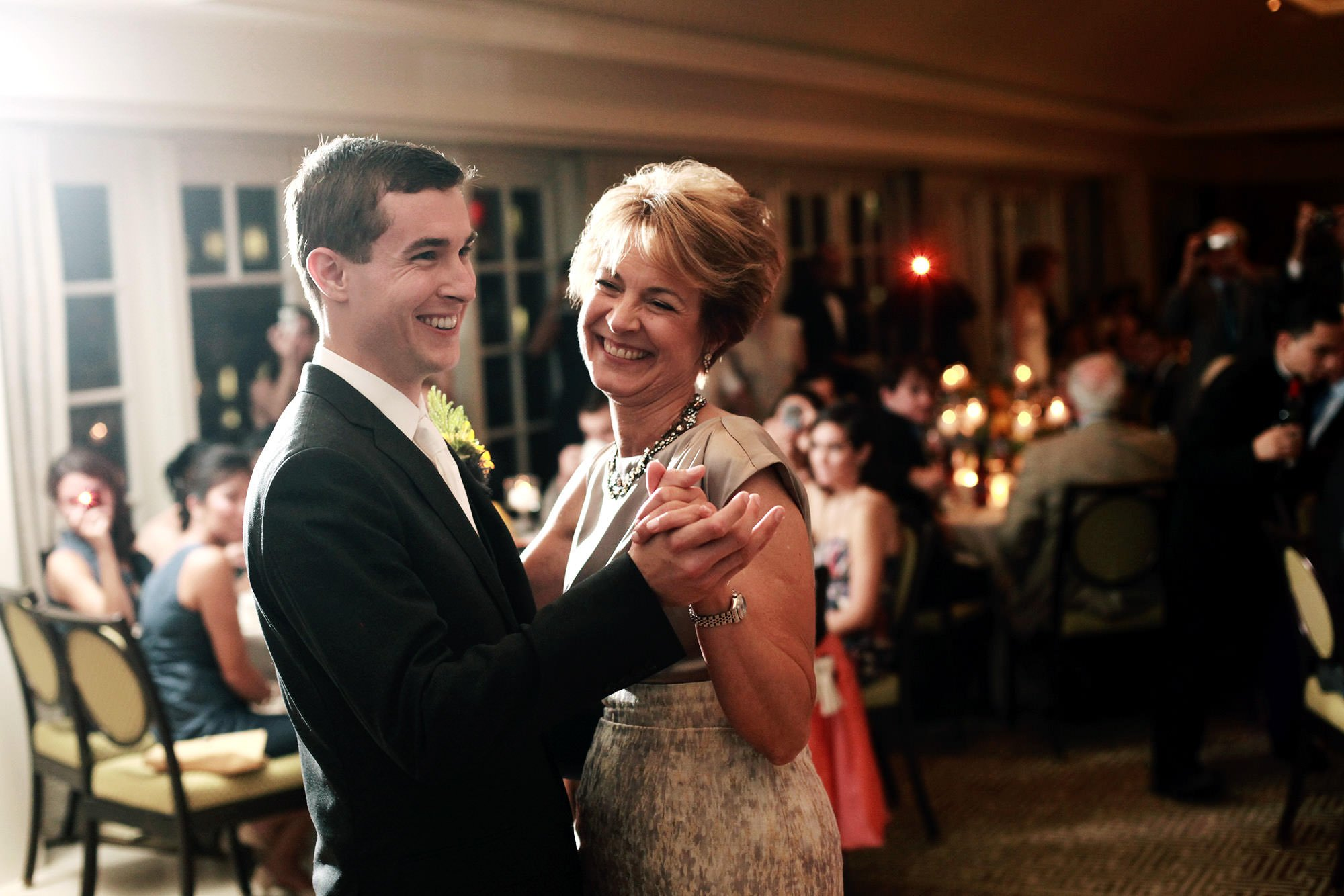 The groom dances with his mother during the wedding reception at the Hay Adams hotel.