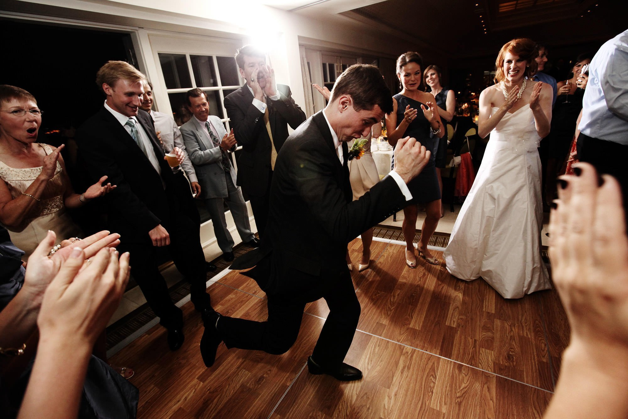 The groom dances during his Hay Adams wedding reception.