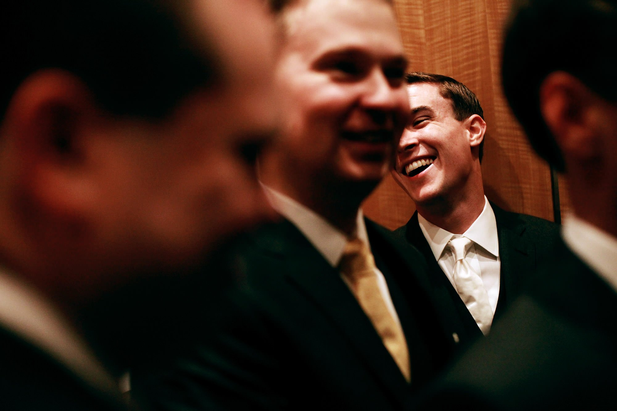 The groom smiles in an elevator on his way to his Hay Adams wedding ceremony.
