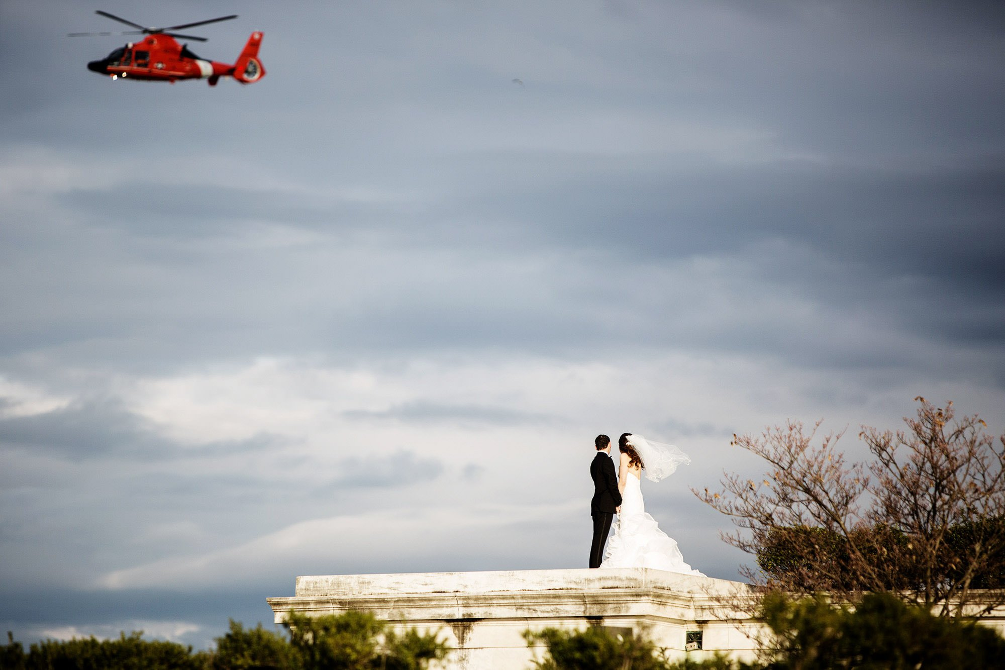 The couple watches as a helicopter passes overhead at the Jefferson Memorial in Washington, DC.
