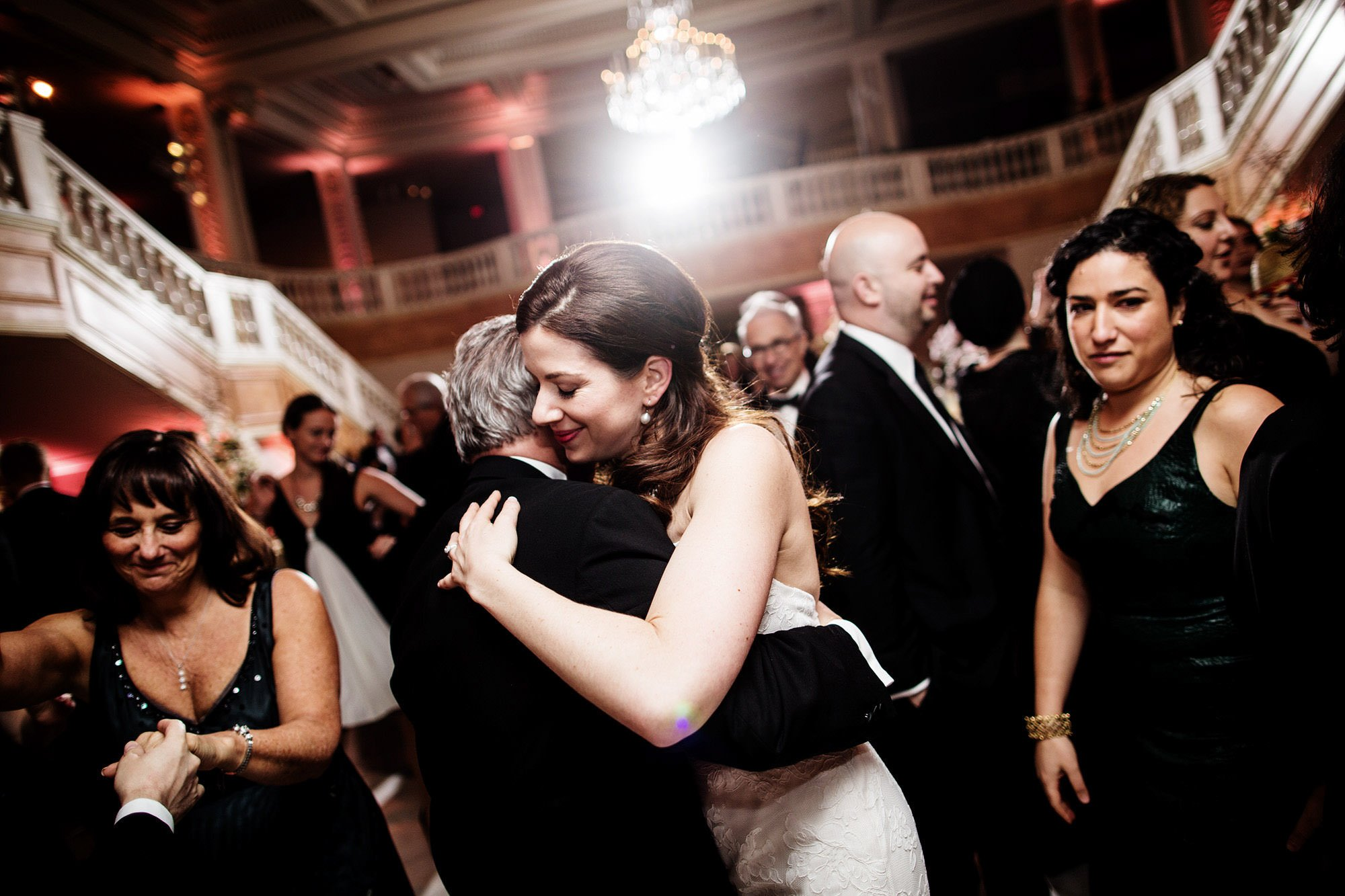The bride dances with guests during her NMWA wedding reception.