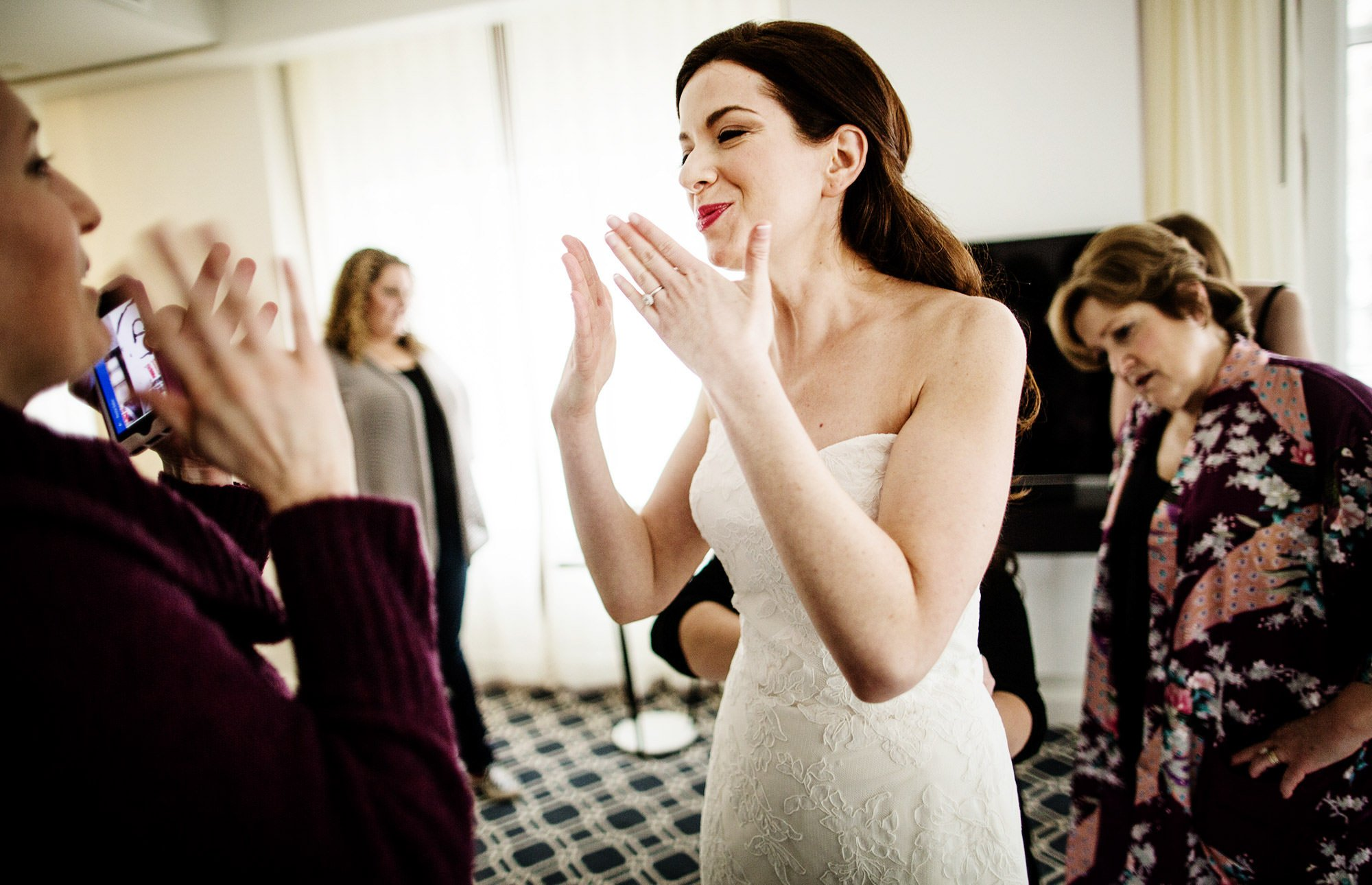 The bride blows kisses at her bridesmaids at the Sofitel in Washington, DC prior to the NMWA wedding.