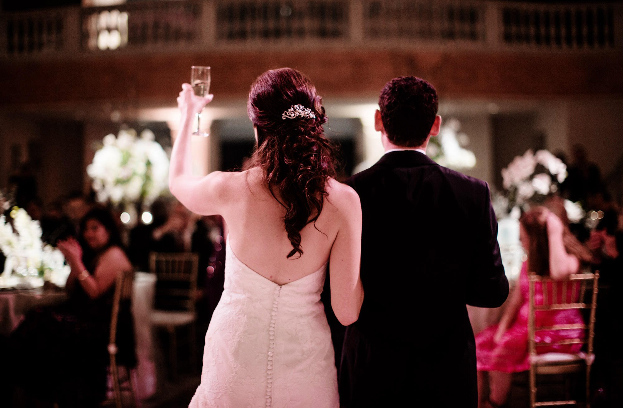 The bride and groom gives a toast during their NMWA wedding reception.