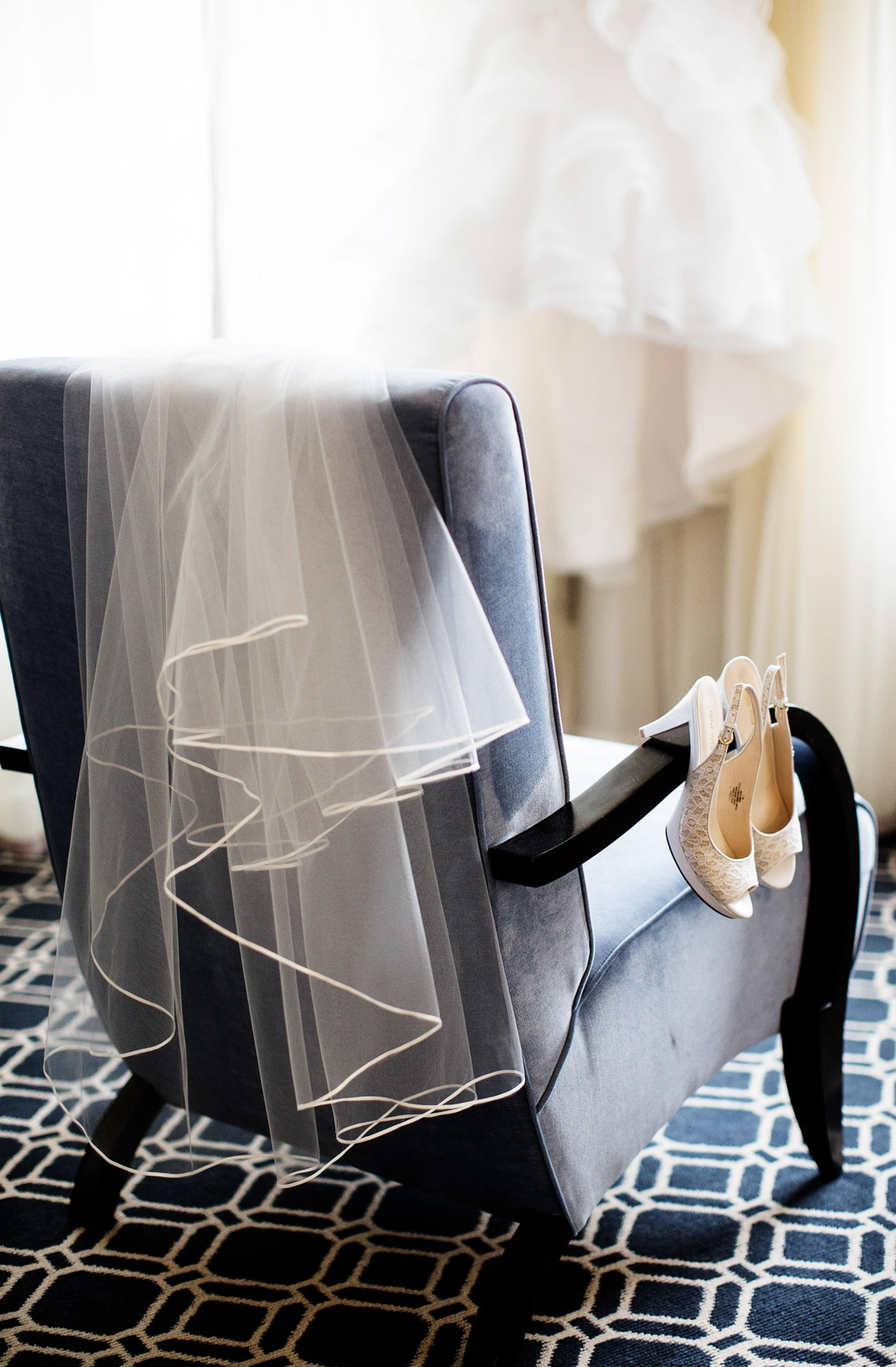 A detail of the bride's veil and shoes at the Sofitel in Washington, DC prior to the NMWA DC wedding.