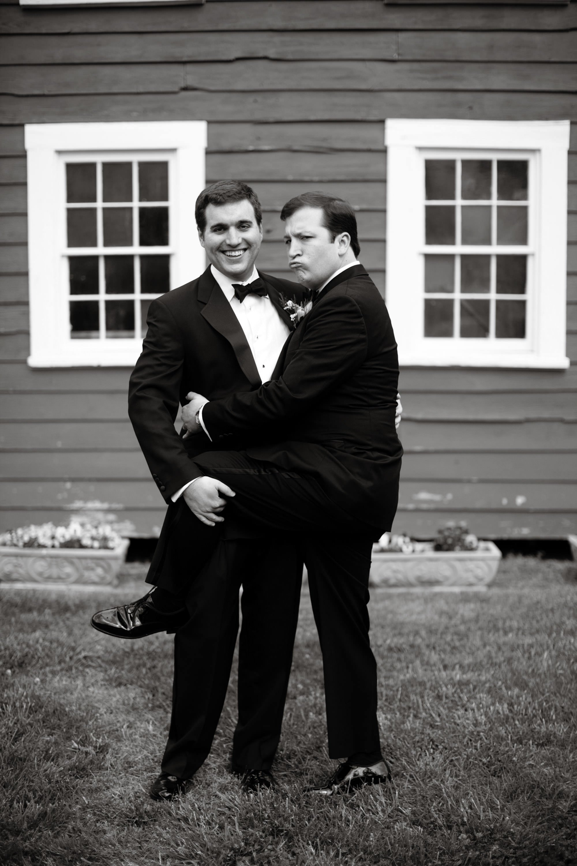 A fun portrait of the groom and one of his groomsmen.