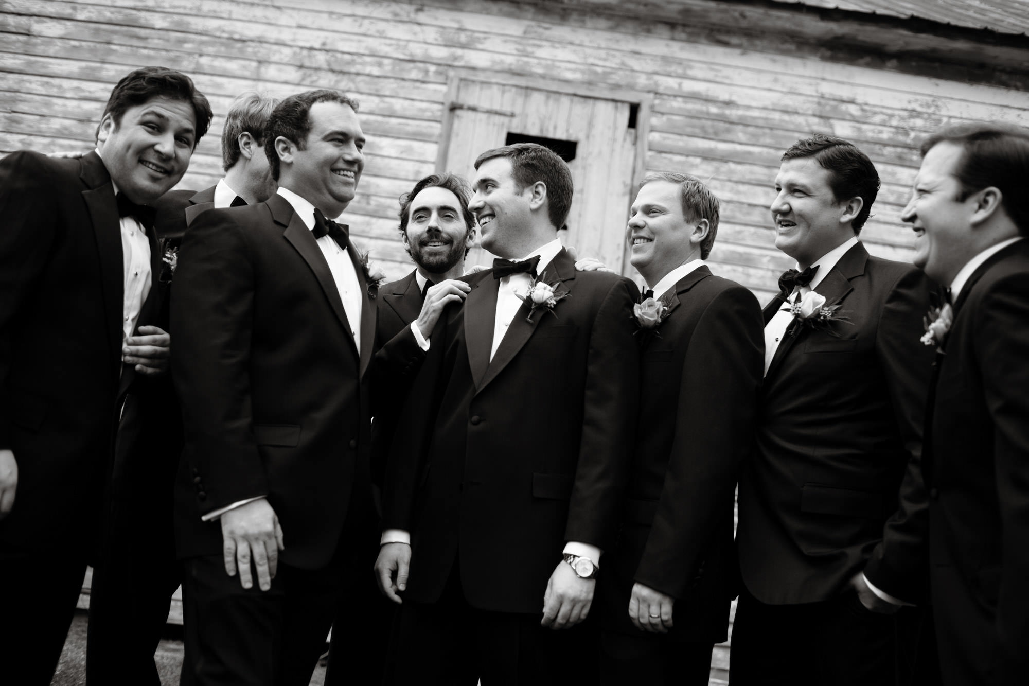 The groomsmen pose for a portrait on the Oaks Waterfront Inn and Events Wedding day.