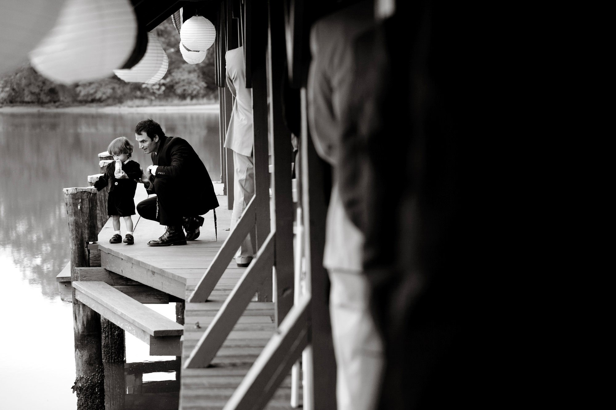 A child takes a break during the wedding ceremony