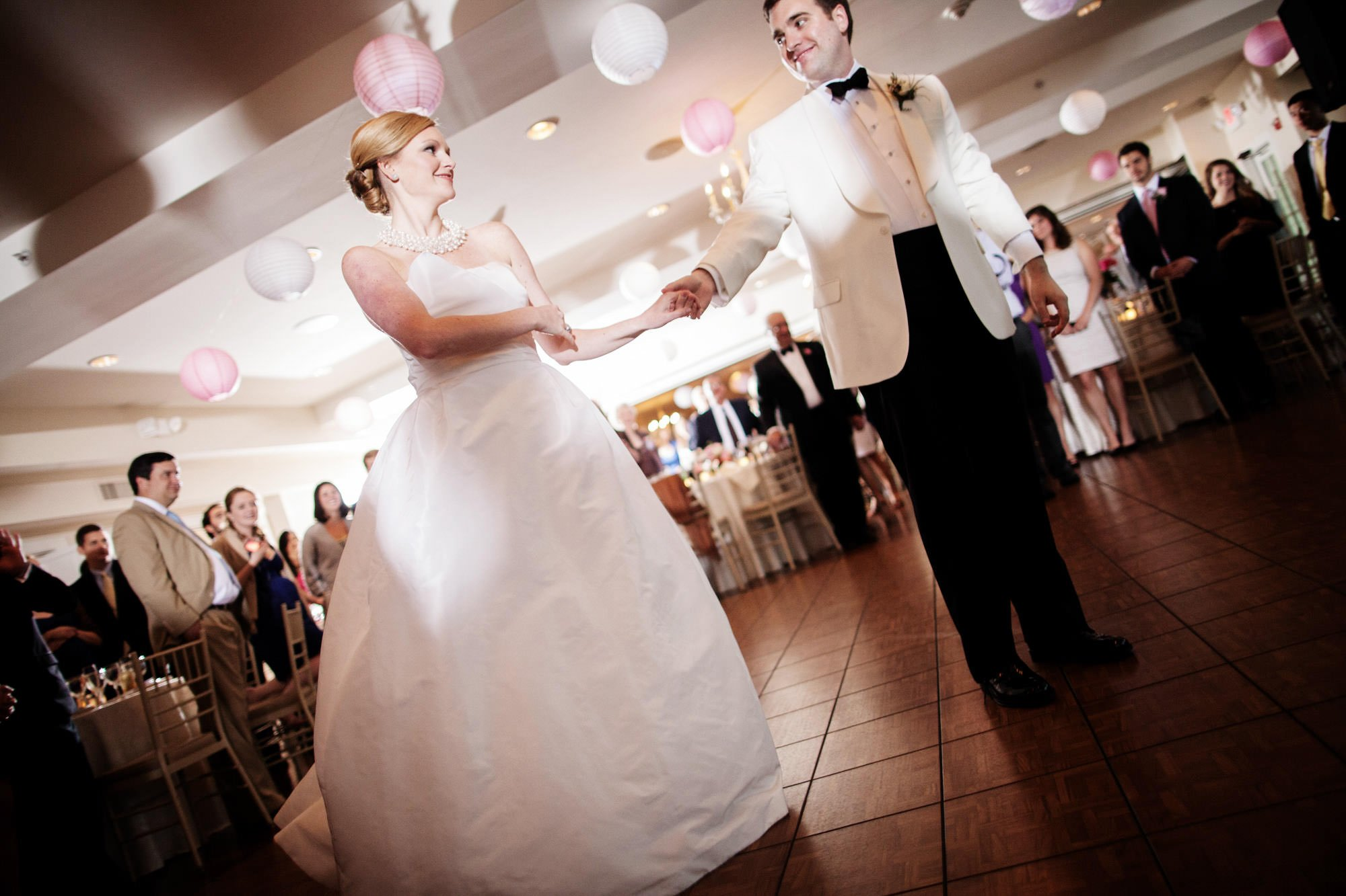 The bride and groom dance during the wedding reception at Oaks Waterfront Inn and Events.