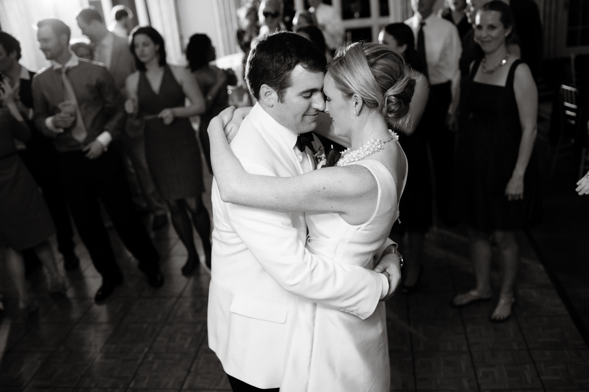 The couple dances during the reception at their Oaks Waterfront Inn and Events Wedding.