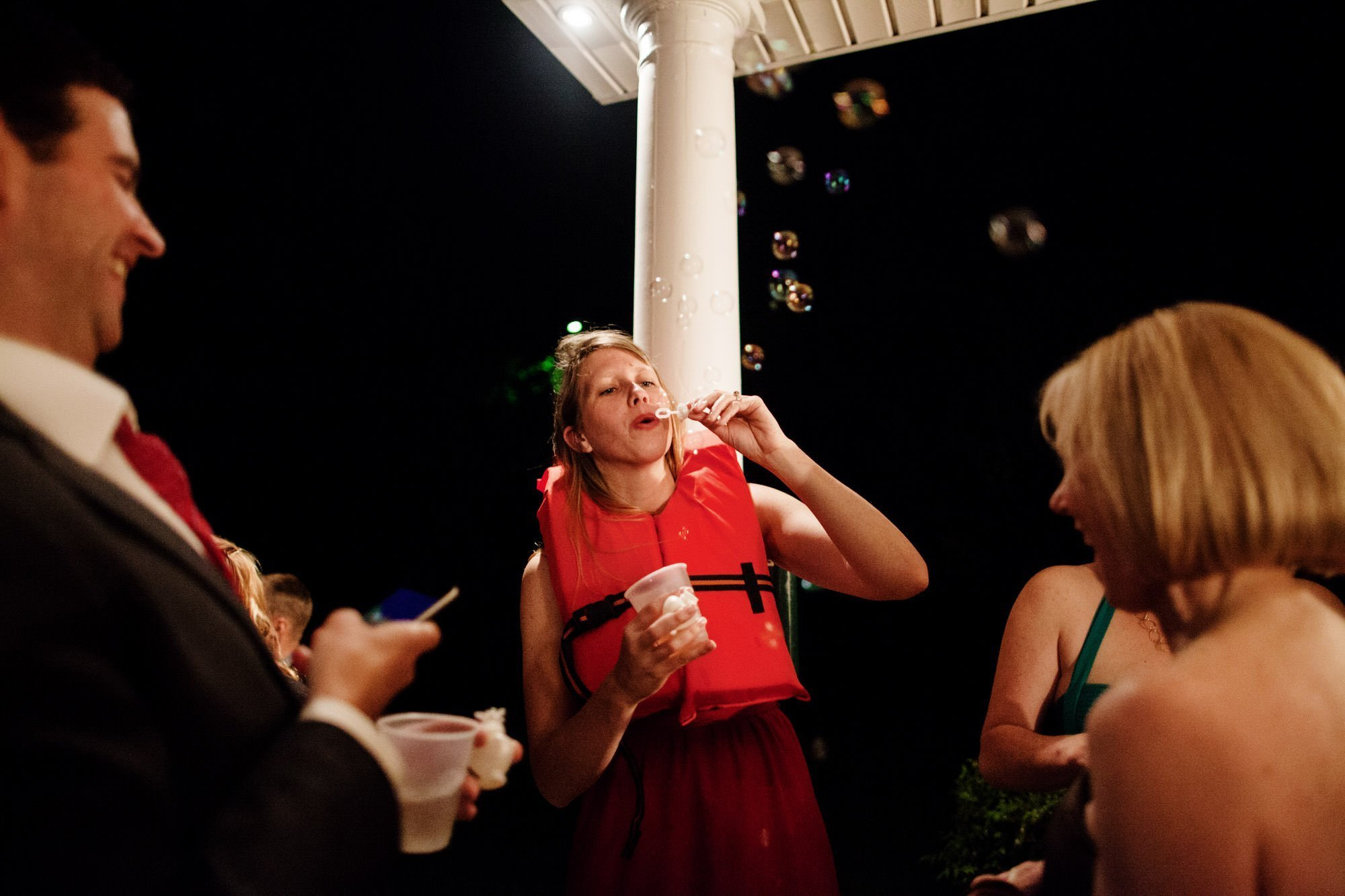 Guests blow bubbles during the wedding reception.