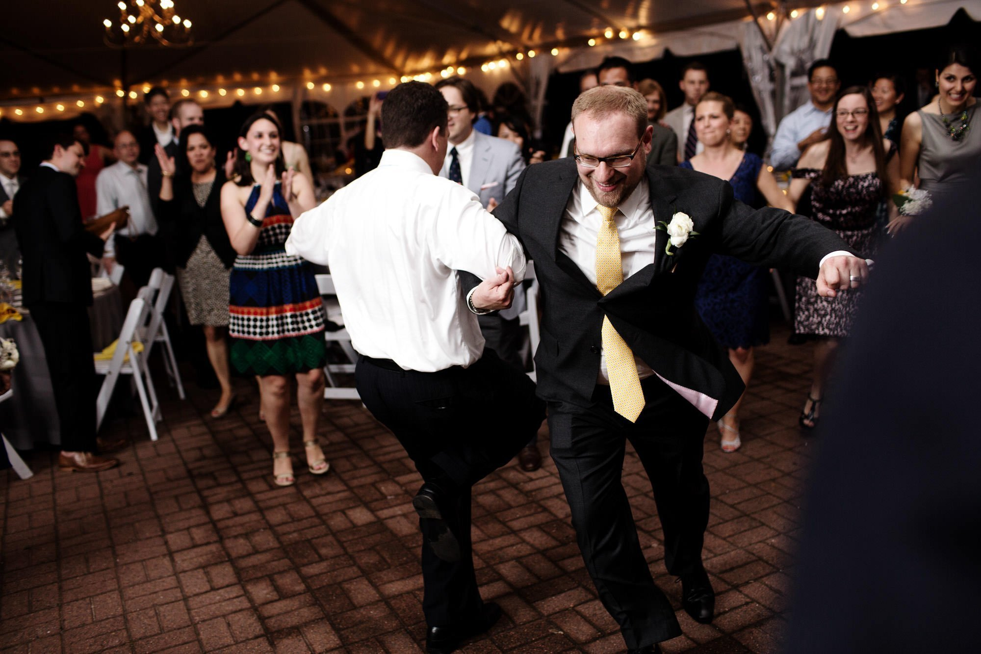 Wedding guests dance during the wedding reception at Oxon Hill Manor.