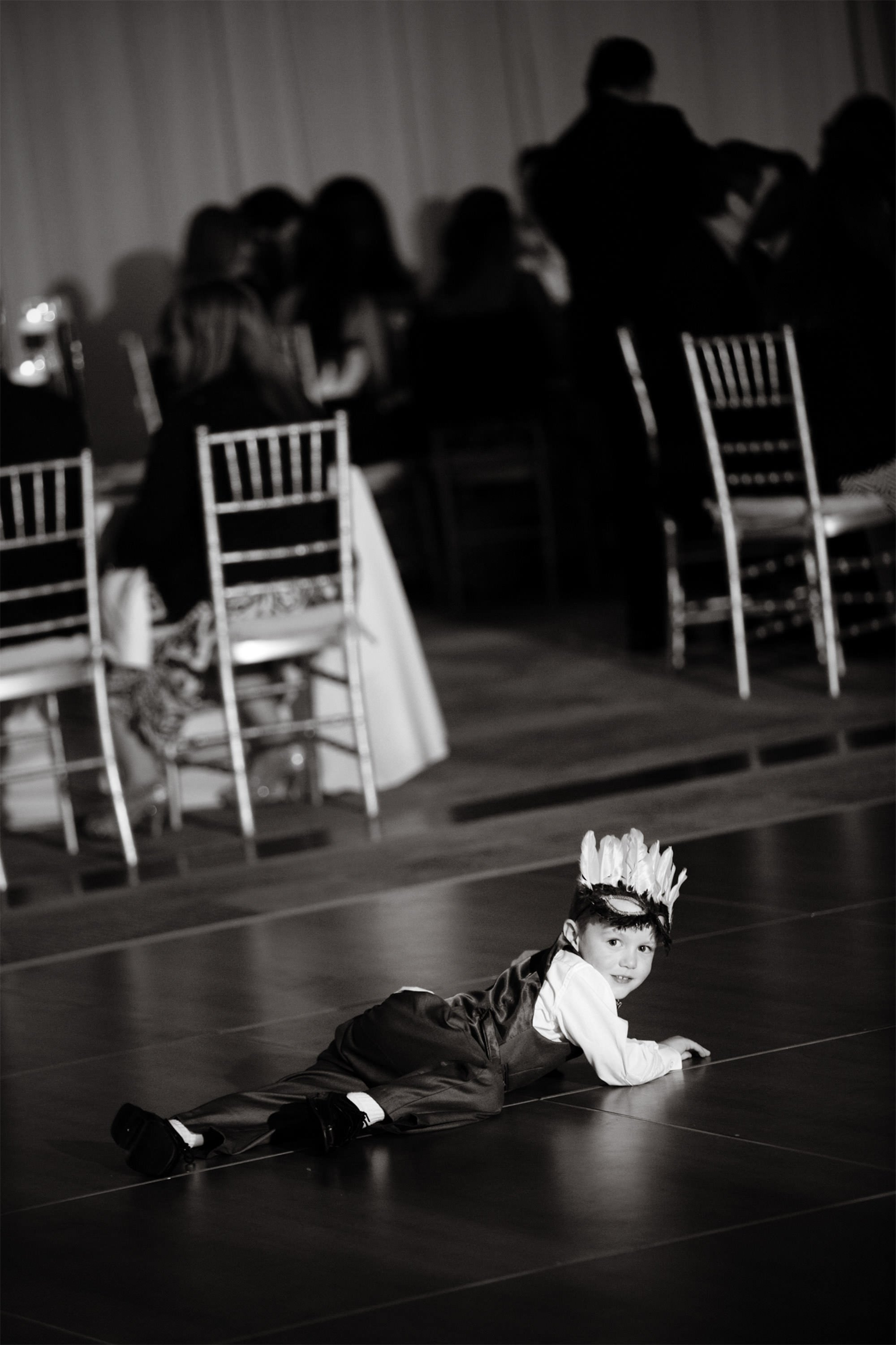 A child crawls on the dance floor during the Park Hyatt DC wedding reception.