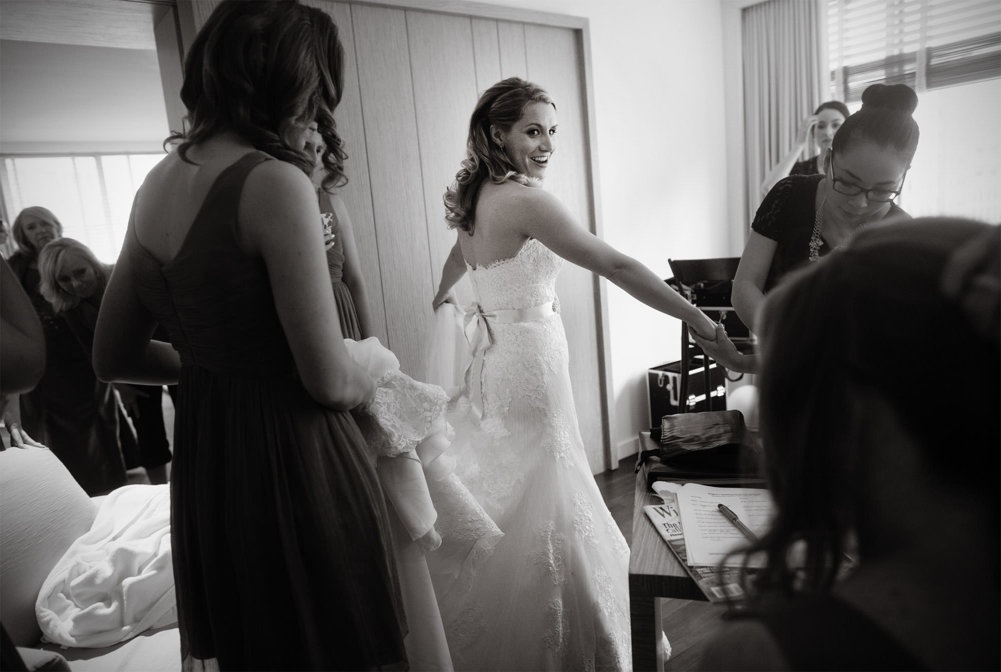 The bride puts on her wedding dress before the ceremony at Park Hyatt Washington DC.