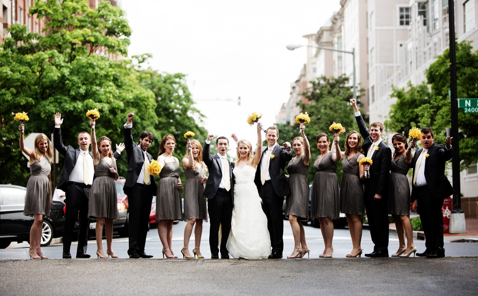 The wedding party poses in the street in Washington DC.