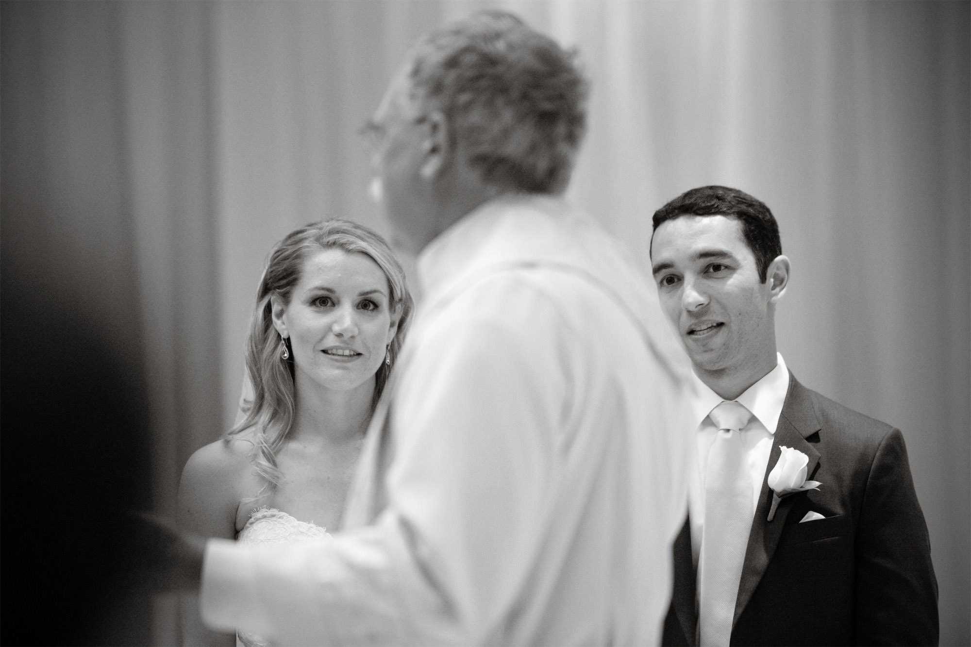 The bride and groom watch the officiant during the wedding ceremony at the Park Hyatt in Washington DC.