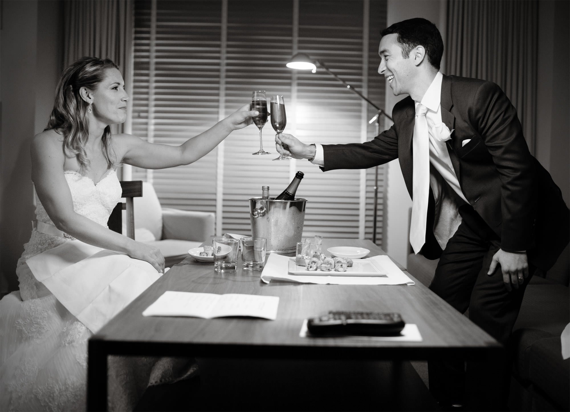 The couple toasts during a private moment following their wedding ceremony at the Park Hyatt in Washington DC.