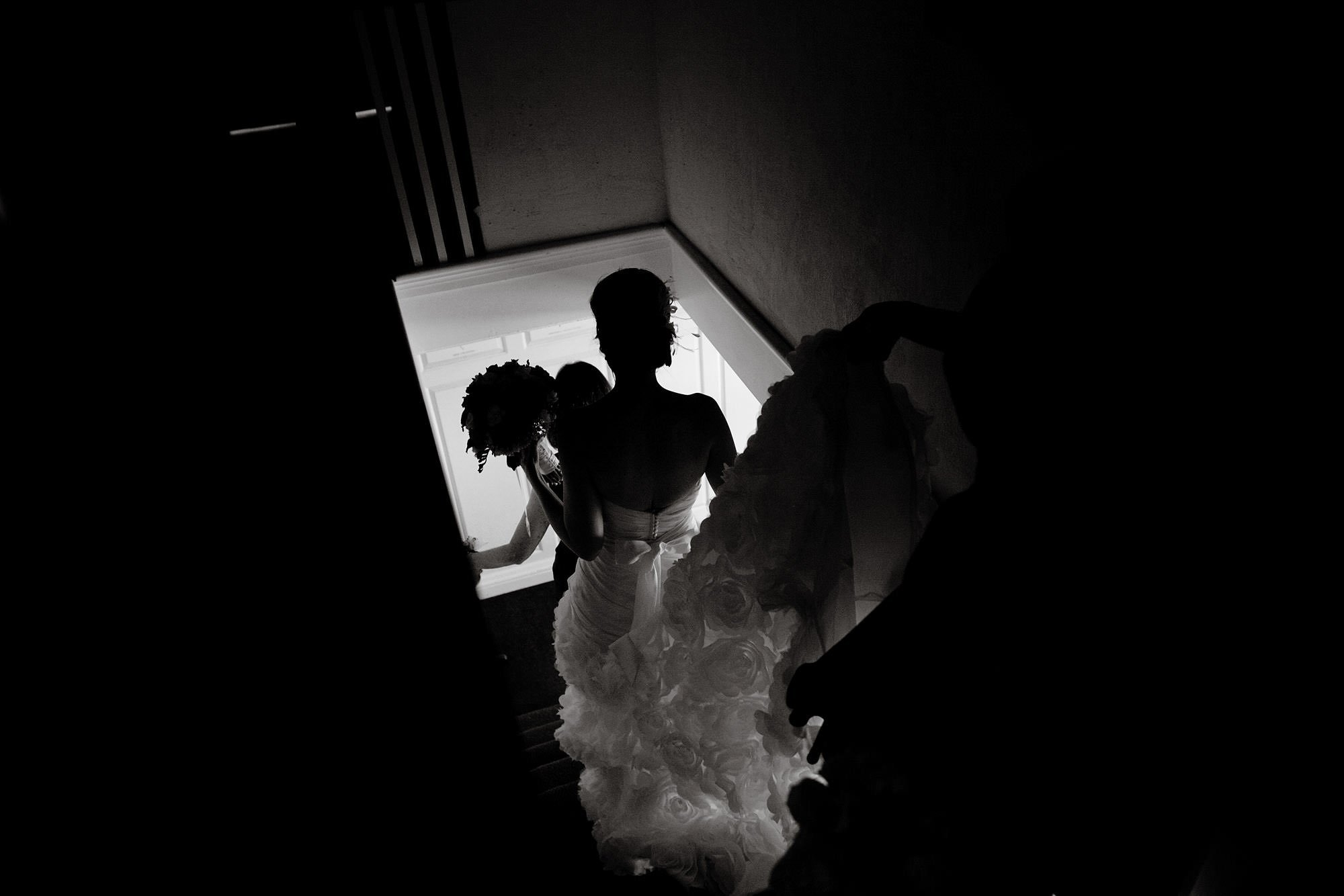 The bride walks down the stairs before the River Farm Alexandria Wedding ceremony.