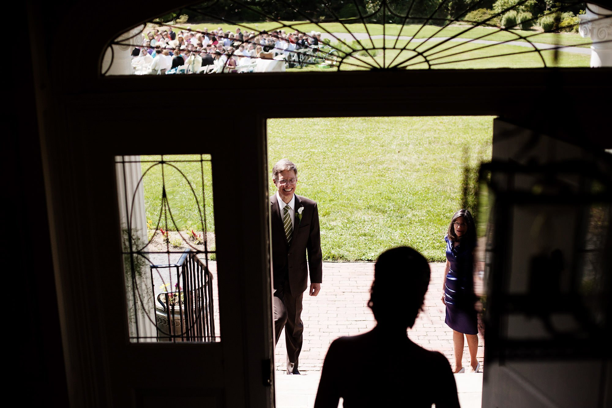 The father of the bride greets his daughter before the River Farm Alexandria Wedding ceremony.