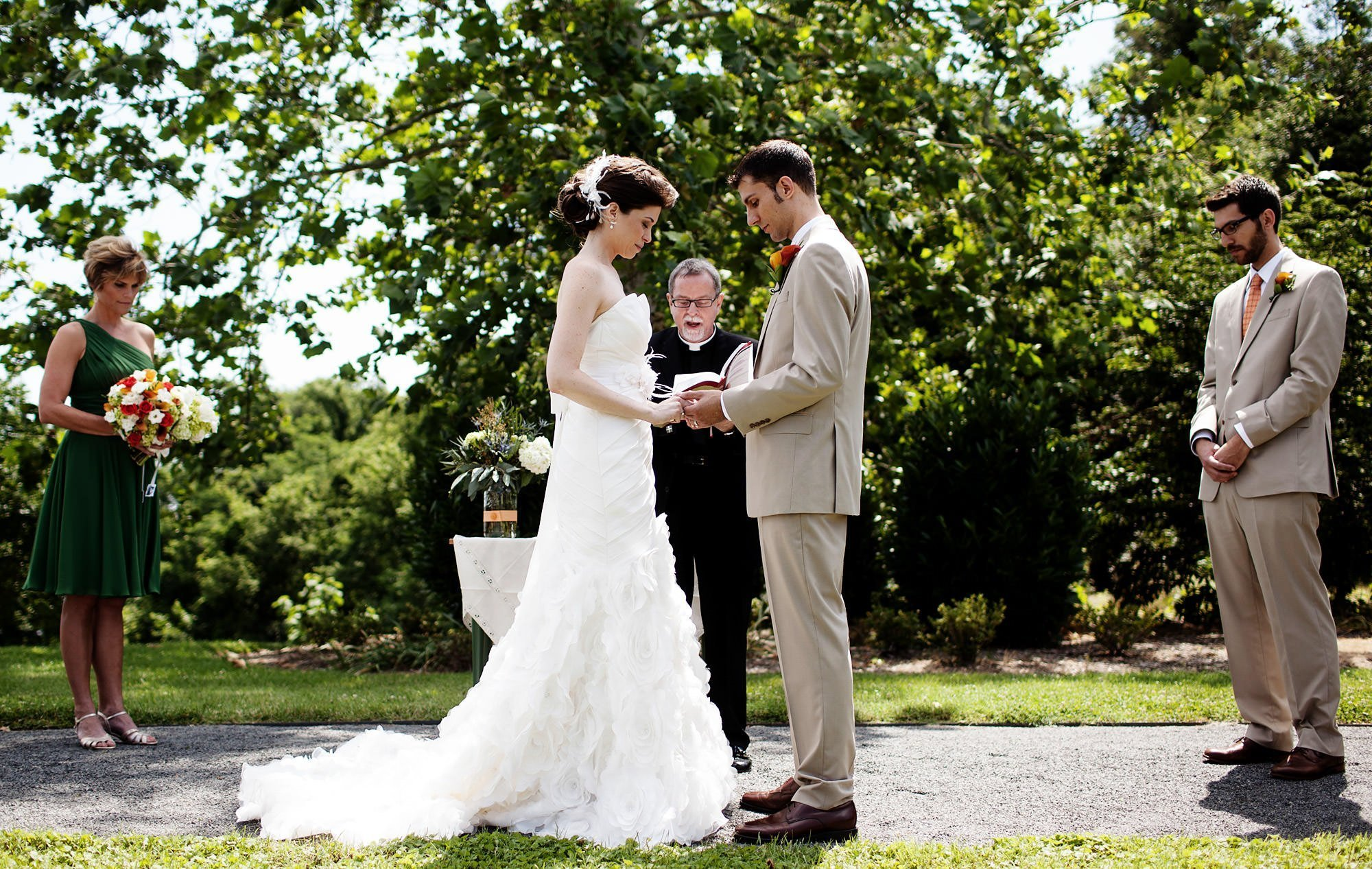 The bride and groom participate in their River Farm Alexandria Wedding ceremony.