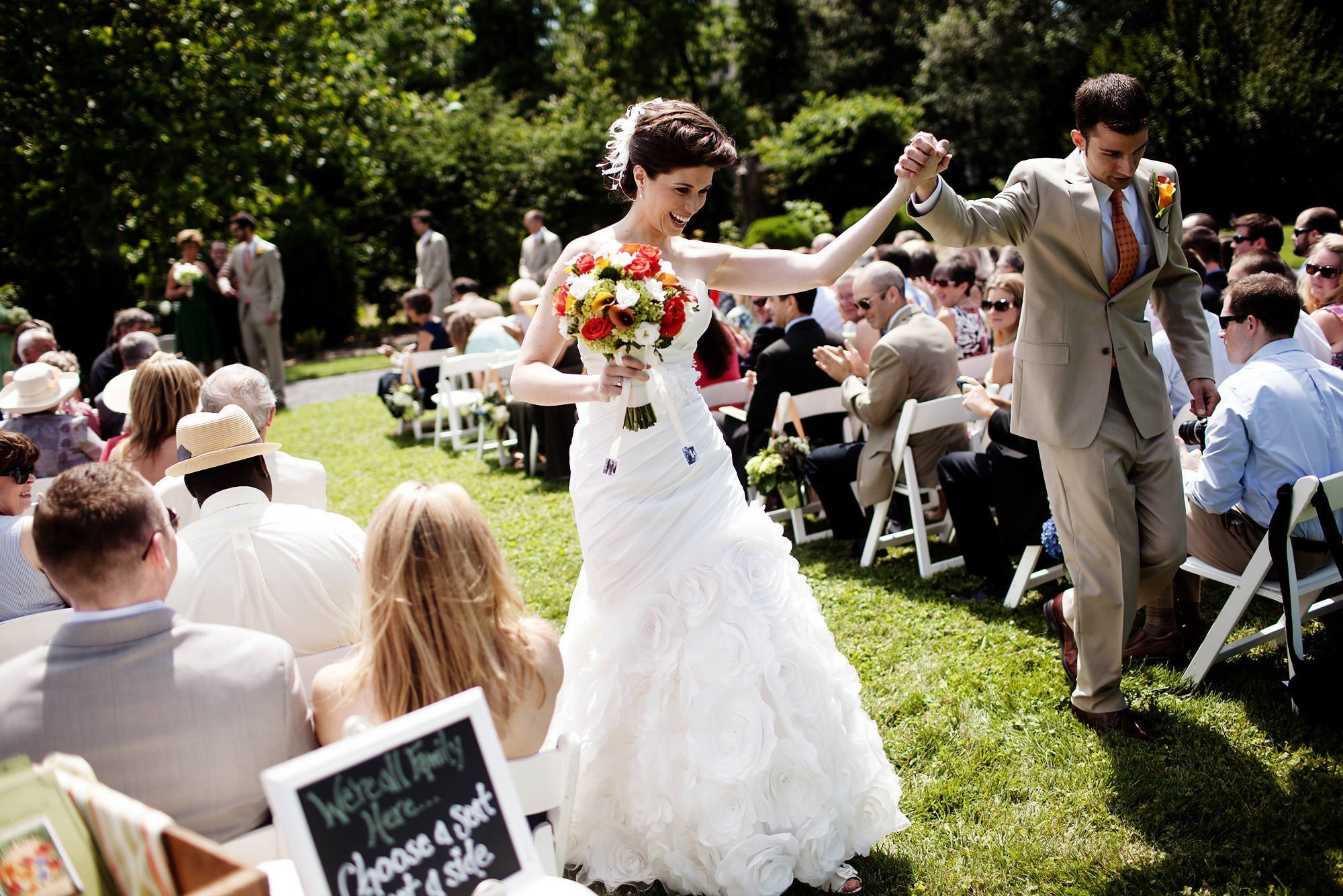 The bride and groom walk down the aisle after their River Farm Alexandria Wedding ceremony.